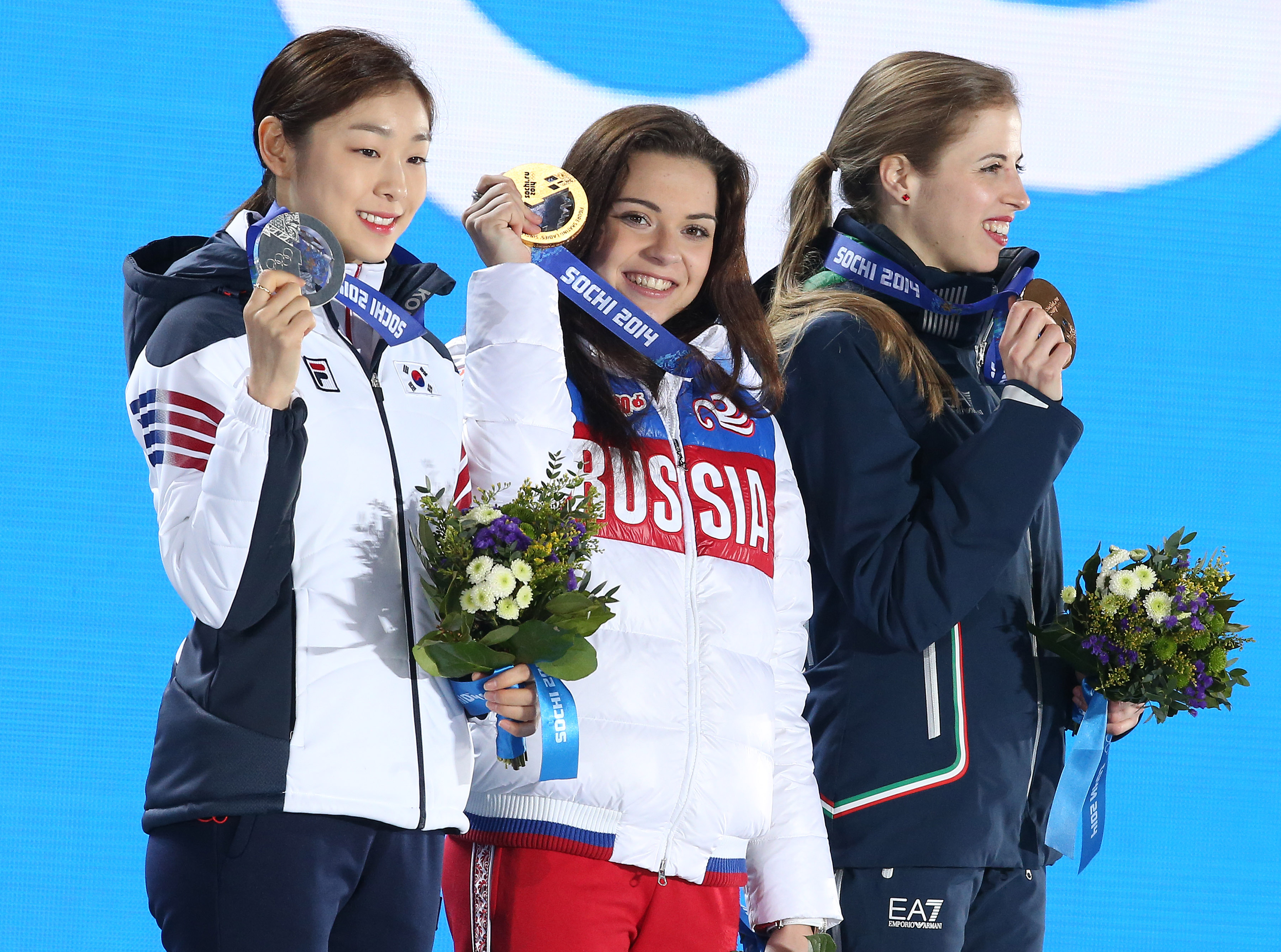Silver medalist Yuna Kim of South Korea, Gold medalist Adelina Sotnikova of Russia and Bronze medalist Carolina Kostner of Italy celebrate during the medal ceremony for the Women's Free Figure Skating on day fourteen of the Sochi 2014 Winter Olympics at Medals Plaza on February 21, 2014 in Sochi, Russia. (Photo by John Berry/Getty Images)