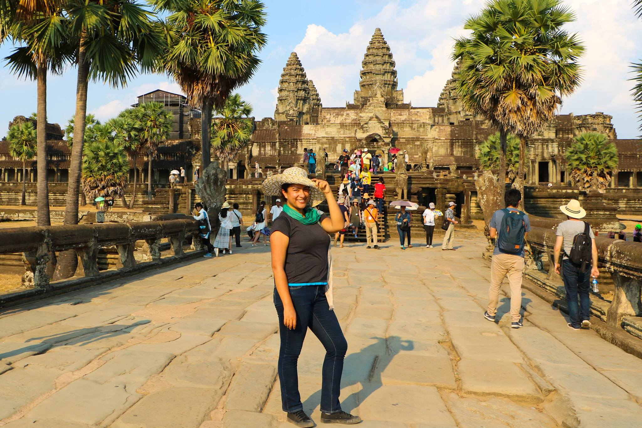 Carolina Borrás standing in front of the Angkor Wat temple in Cambodia