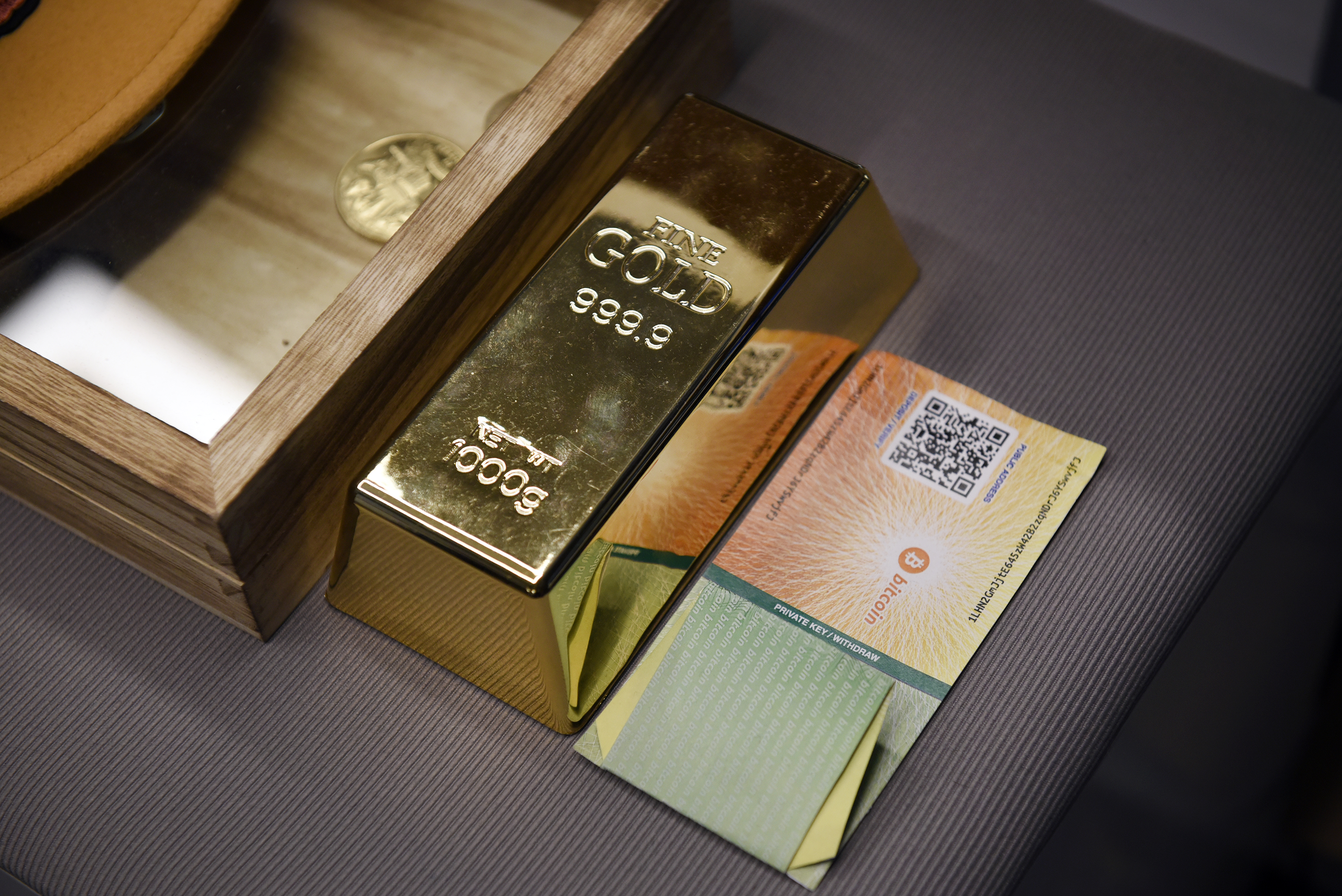 A fake gold bar sits on a table at the Coinbase Inc. office in San Francisco, California, U.S., on Friday, Dec. 1, 2017. Coinbase wants to use digital money to reinvent finance. In the company's version of the future, loans, venture capital, money transfers, accounts receivable and stock trading can all be done with electronic currency, using Coinbase instead of banks.