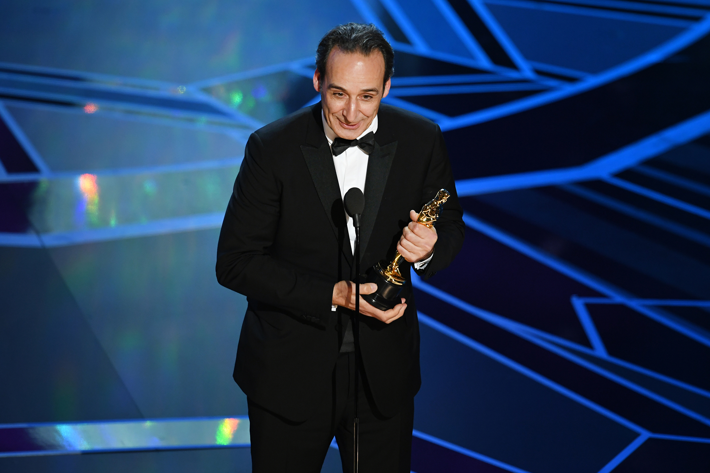 Composer Alexandre Desplat accepts Best Original Score for 'The Shape of Water' onstage during the 90th Annual Academy Awards at the Dolby Theatre at Hollywood & Highland Center on March 4, 2018 in Hollywood.