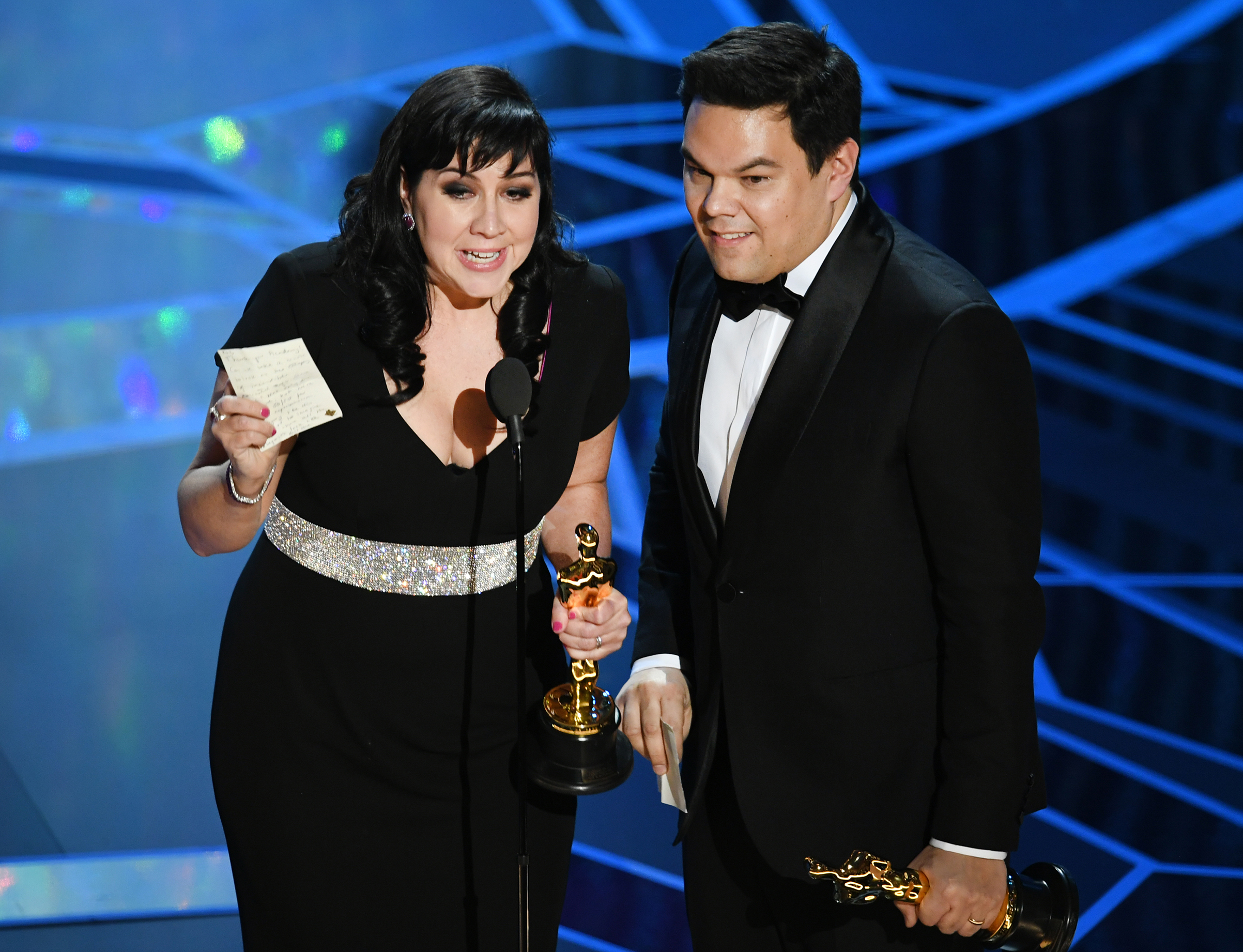 Songwriters Kristen Anderson-Lopez and Robert Lopez accept Best Original Song for 'Remember Me' from 'Coco' onstage during the 90th Annual Academy Awards at the Dolby Theatre at Hollywood & Highland Center on March 4, 2018 in Hollywood.