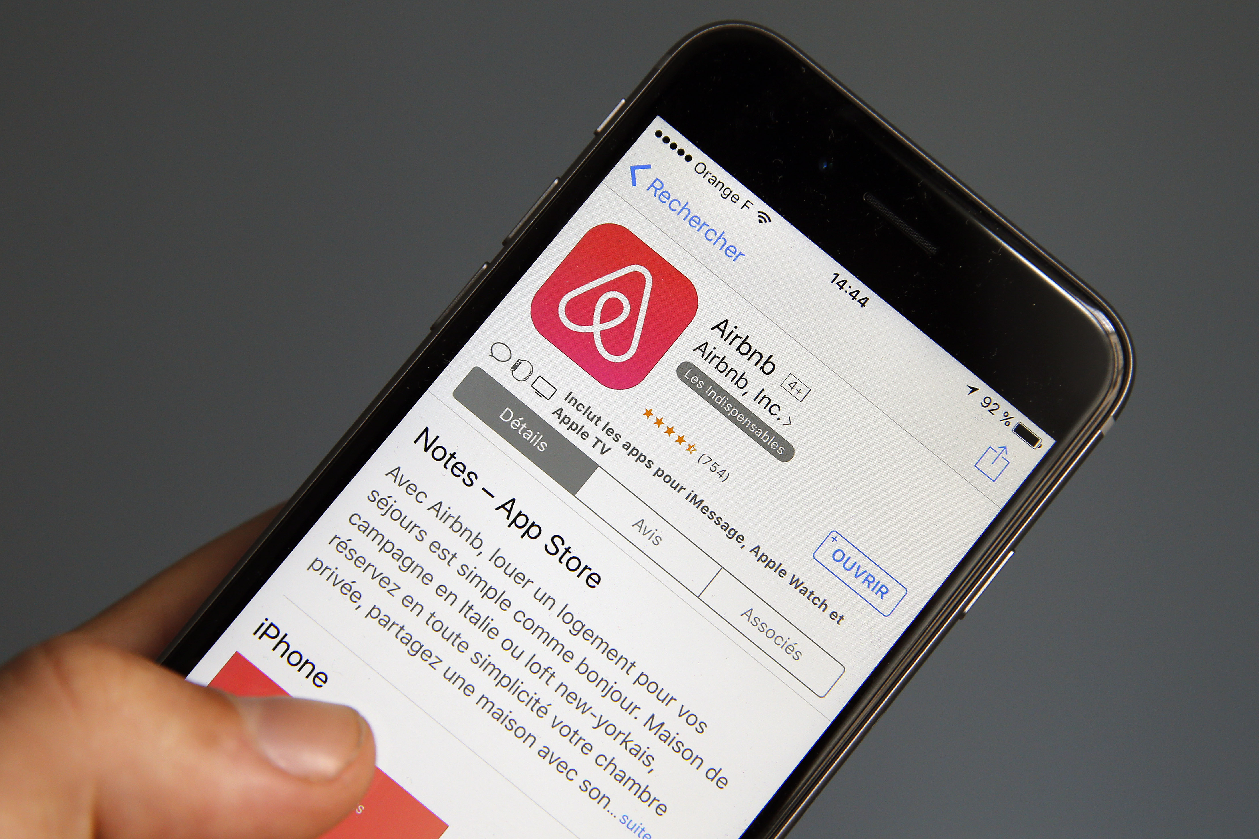 In this photo illustration, the Airbnb company logo is displayed on the screen of an Apple iPhone 6 on Sept. 8, 2017 in Paris, France.
