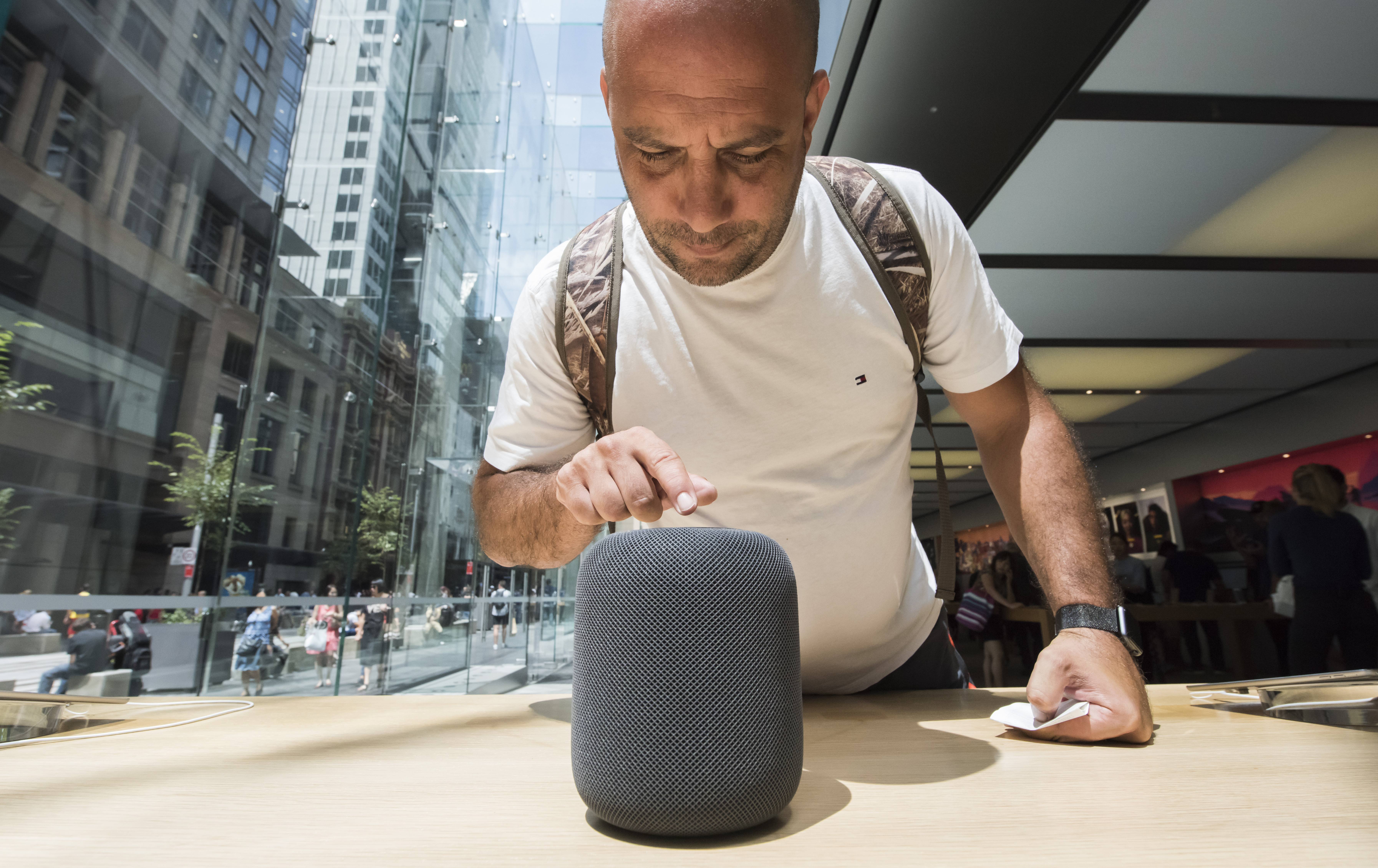 Customers interacting with the new product at the launch of the HomePod at the Apple Store on February 9, 2018 in Sydney, Australia.