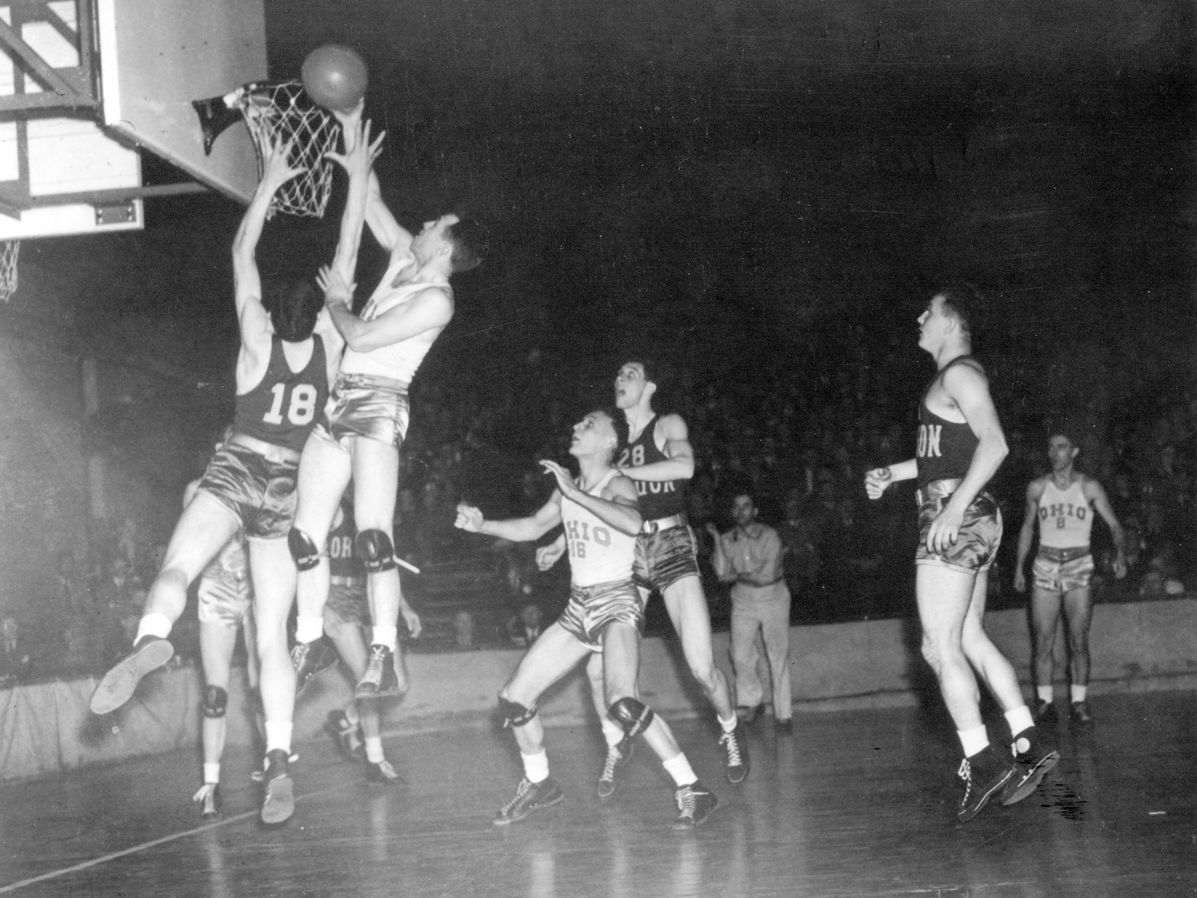 John Schick makes a basket during the first NCAA Men's Basketball National Championship game held in Evanston, Ill., on Mar. 27, 1939.