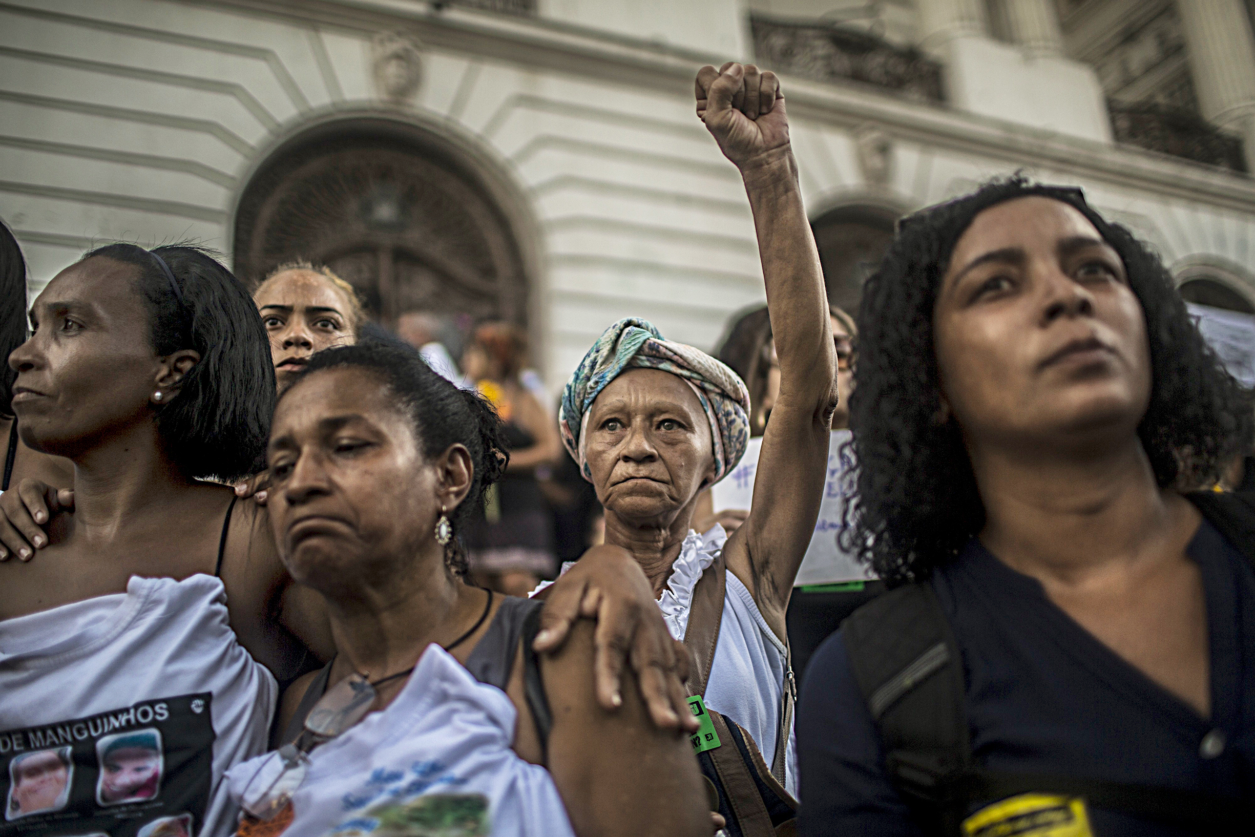 Crowds react as the coffin of fast-rising politician Marielle Franco is carried by in Rio de Janeiro