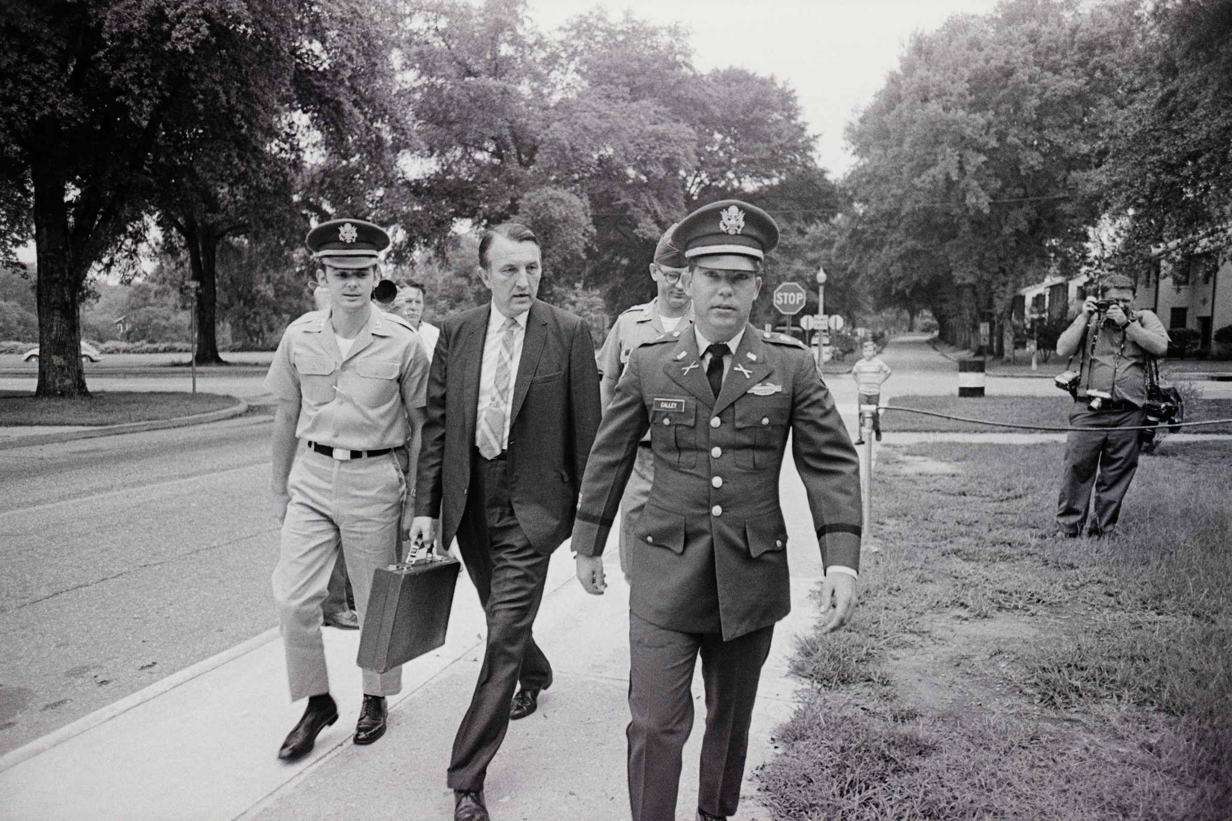 Lieutenant William Calley is flanked by an unidentified civilian assistant attorney (L) and an unidentified Army escort officer as he leaves a closed-door preliminary court martial hearing on Aug. 24, 1970, at Fort Benning, Ga.