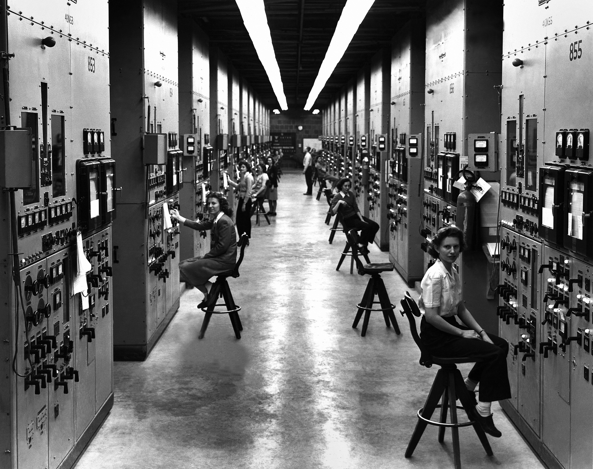 Calutron operators at their panels, in the Y-12 plant at Oak Ridge during World War II. 1944. The calutrons were used to refine uranium ore into fissile material. During the Manhattan Project effort to construct an atomic explosive, workers toiled in secrecy, with no idea to what end their labors were directed. Gladys Owens, the woman seated in the foreground, did not realize what she had been doing until seeing this photo in a public tour of the facility fifty years later. Tennessee, USA.  (Photo by Galerie Bilderwelt/Getty Images)