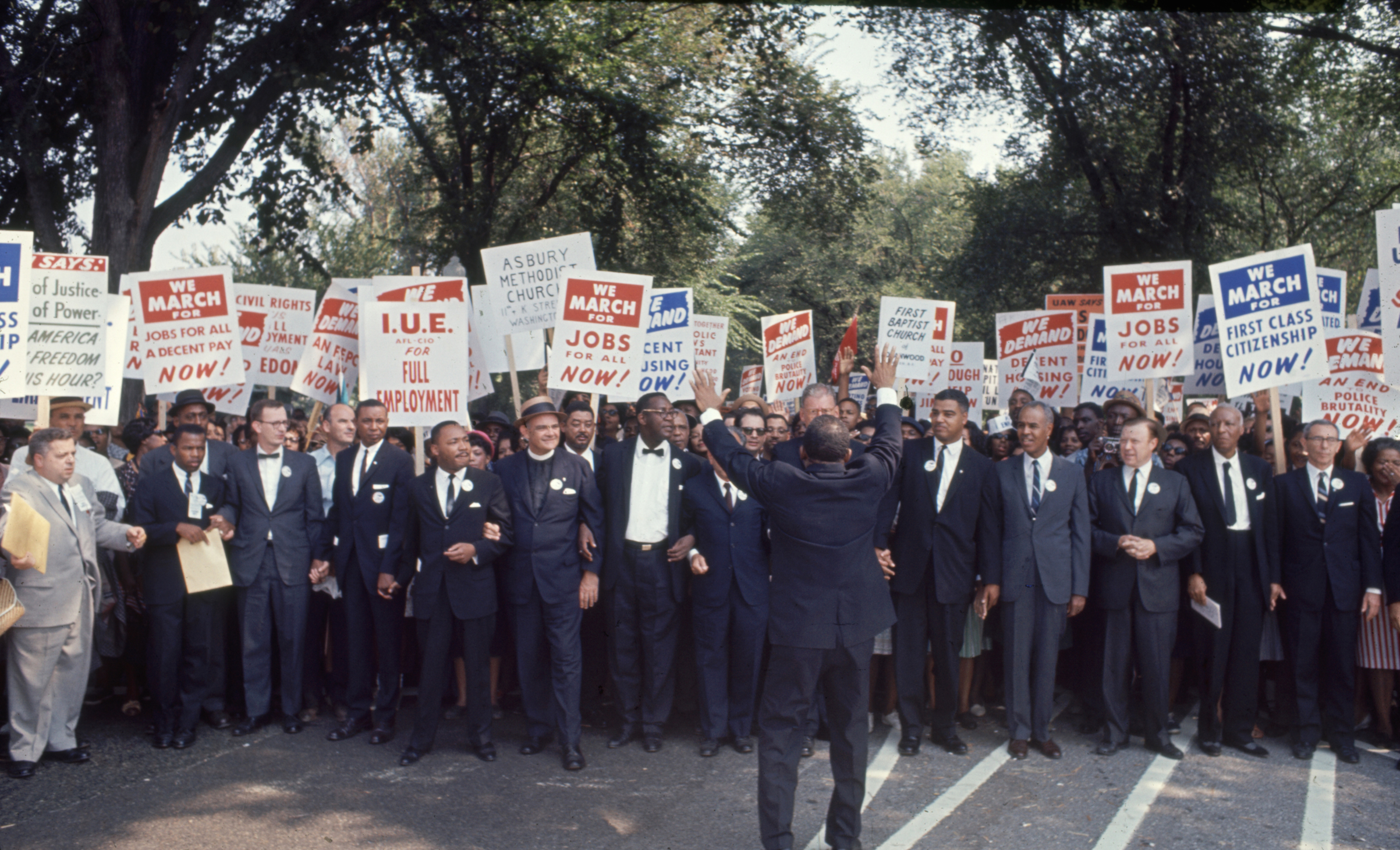 Civil Rights Activist preparing to demonstrate at the March on Washington on Aug. 28, 1963. Martin Luther King Jr. and John Lewis can both be seen on the right side of the frame.