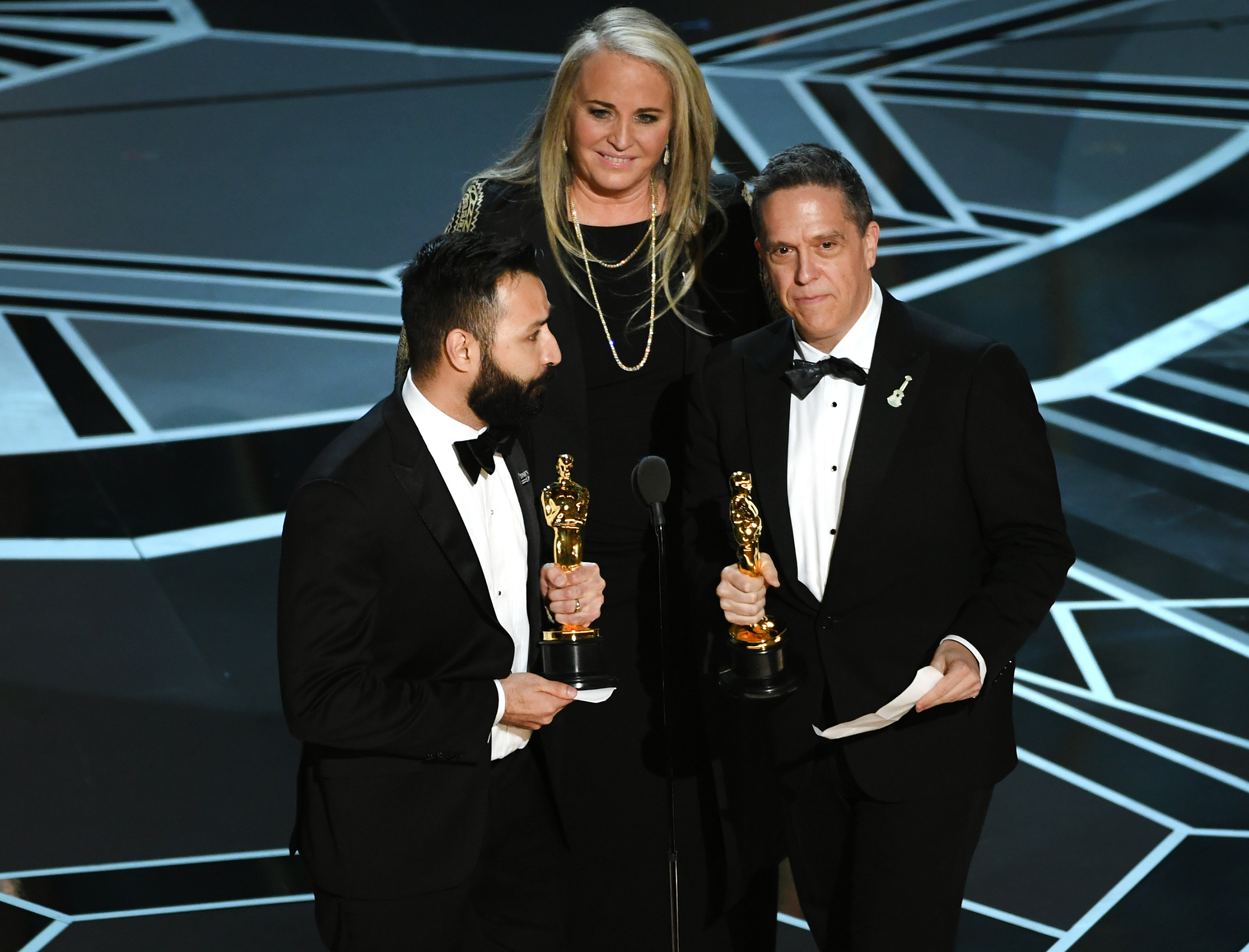 Filmmakers Adrian Molina, Darla K. Anderson and Lee Unkrich accept Best Animated Feature Film for 'Coco' onstage during the 90th Annual Academy Awards at the Dolby Theatre at Hollywood & Highland Center on March 4, 2018 in Hollywood.