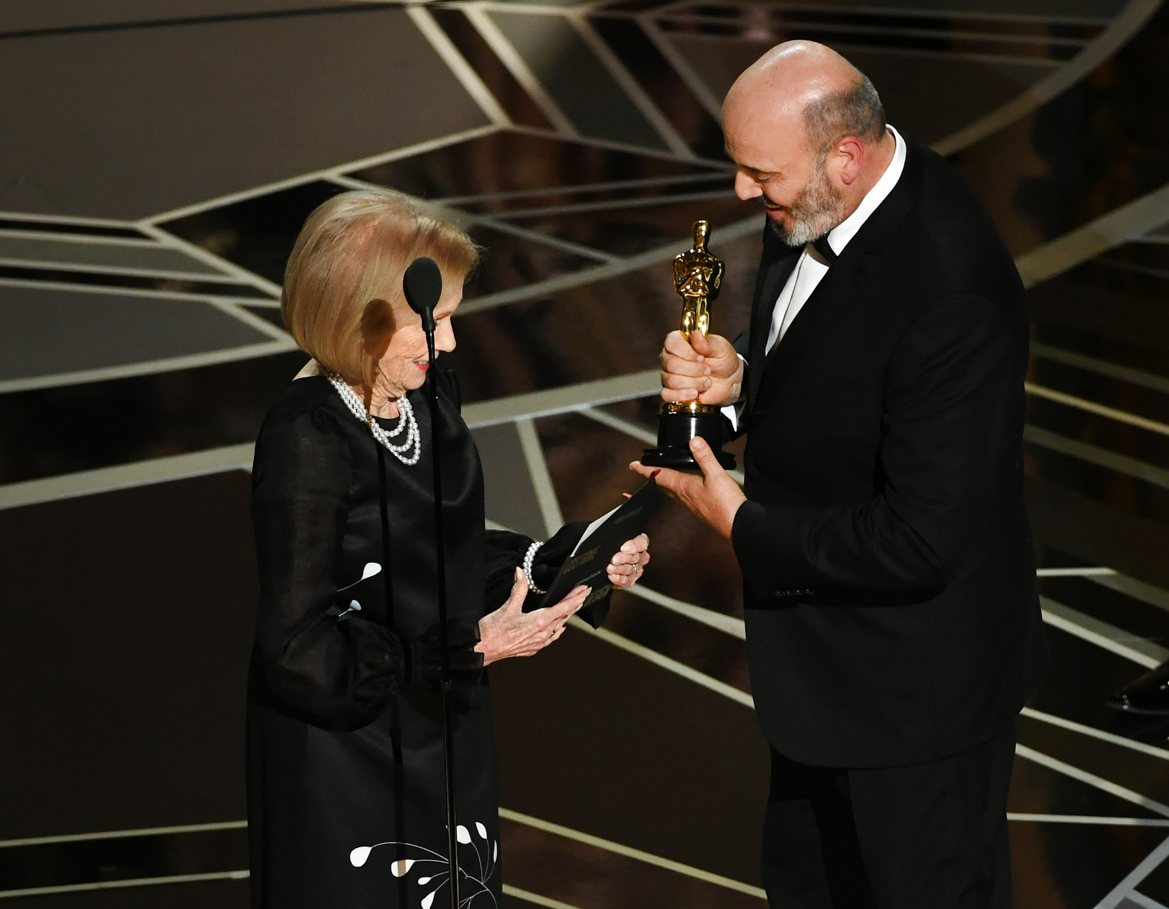 Costume designer Mark Bridges accepts Best Costume Design for 'Phantom Thread' from actor Eva Marie Saint onstage during the 90th Annual Academy Awards at the Dolby Theatre at Hollywood & Highland Center on March 4, 2018 in Hollywood.