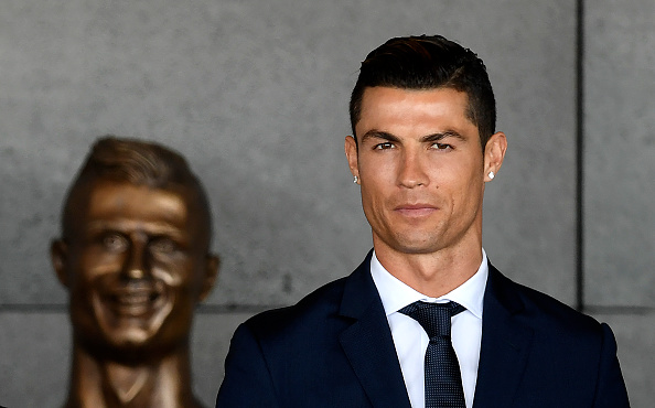 Cristiano Ronaldo stands in front of a bust of himself at Madeira Airport on March 29, 2017.