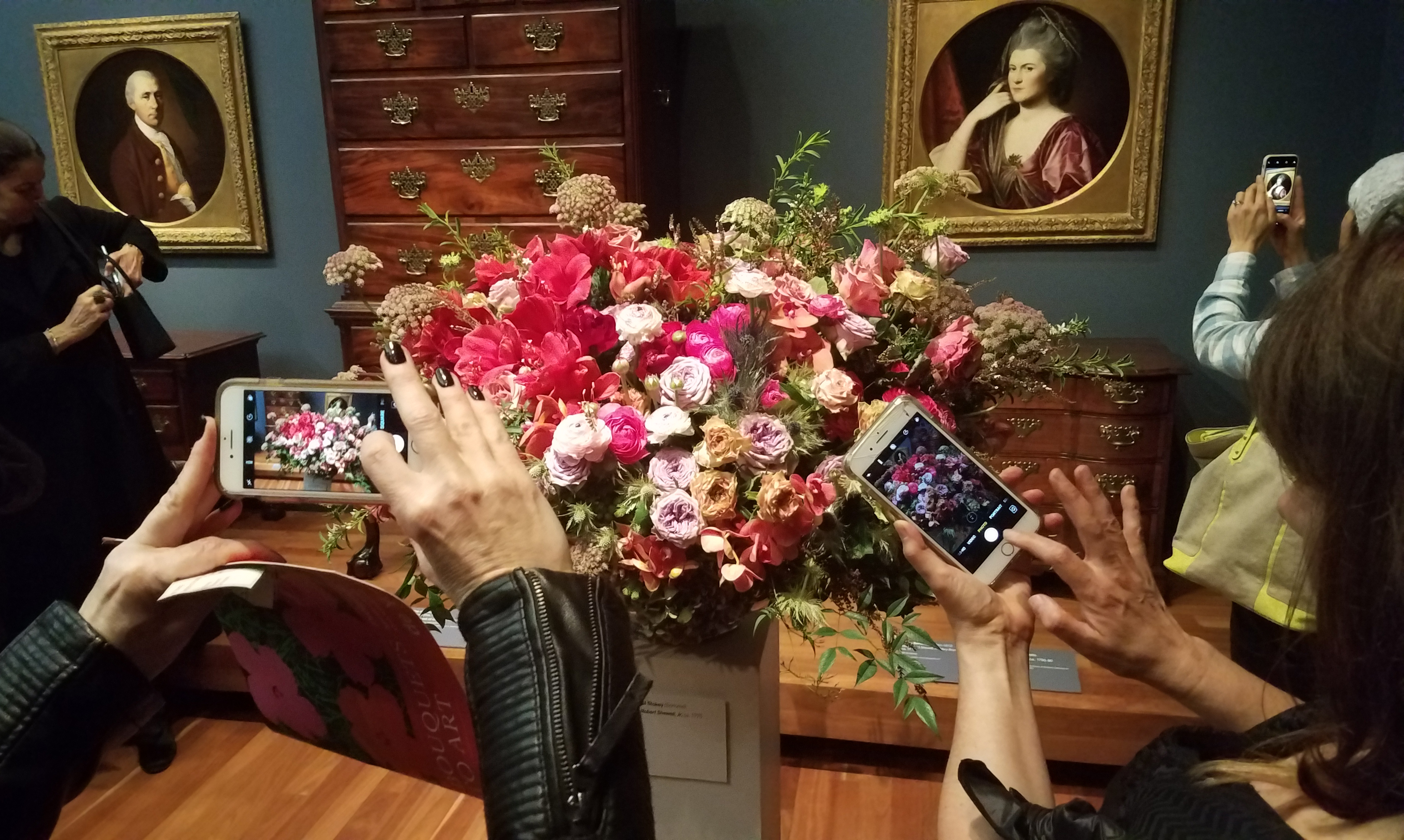 Museum goers take photos at the Bouquets to Art exhibit at the de Young Museum in San Francisco on Wednesday, March 14, 2018.