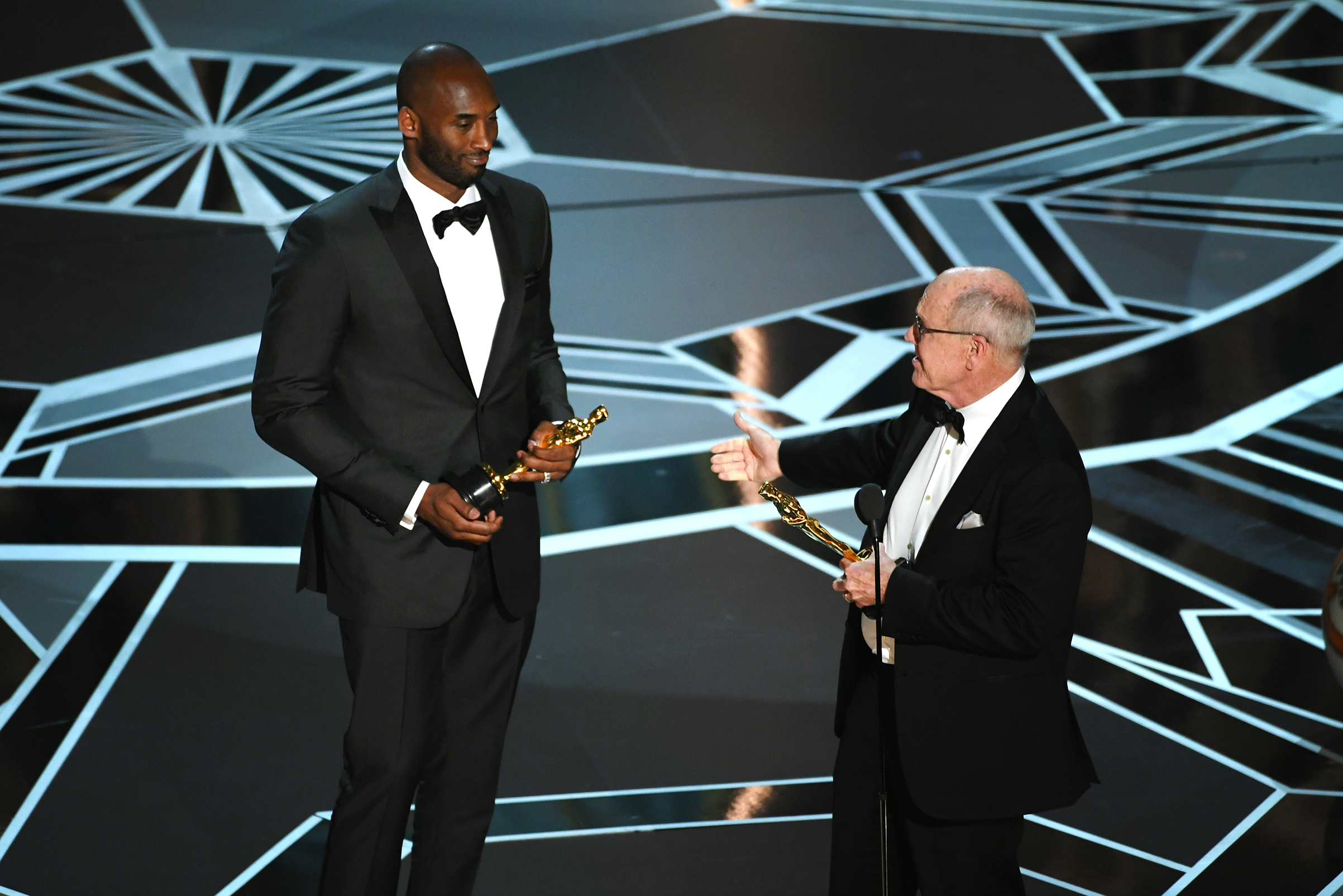 Filmmakers Kobe Bryant and Glen Keane accept Best Animated Short Film for 'Dear Basketball' onstage during the 90th Annual Academy Awards at the Dolby Theatre at Hollywood & Highland Center on March 4, 2018 in Hollywood.