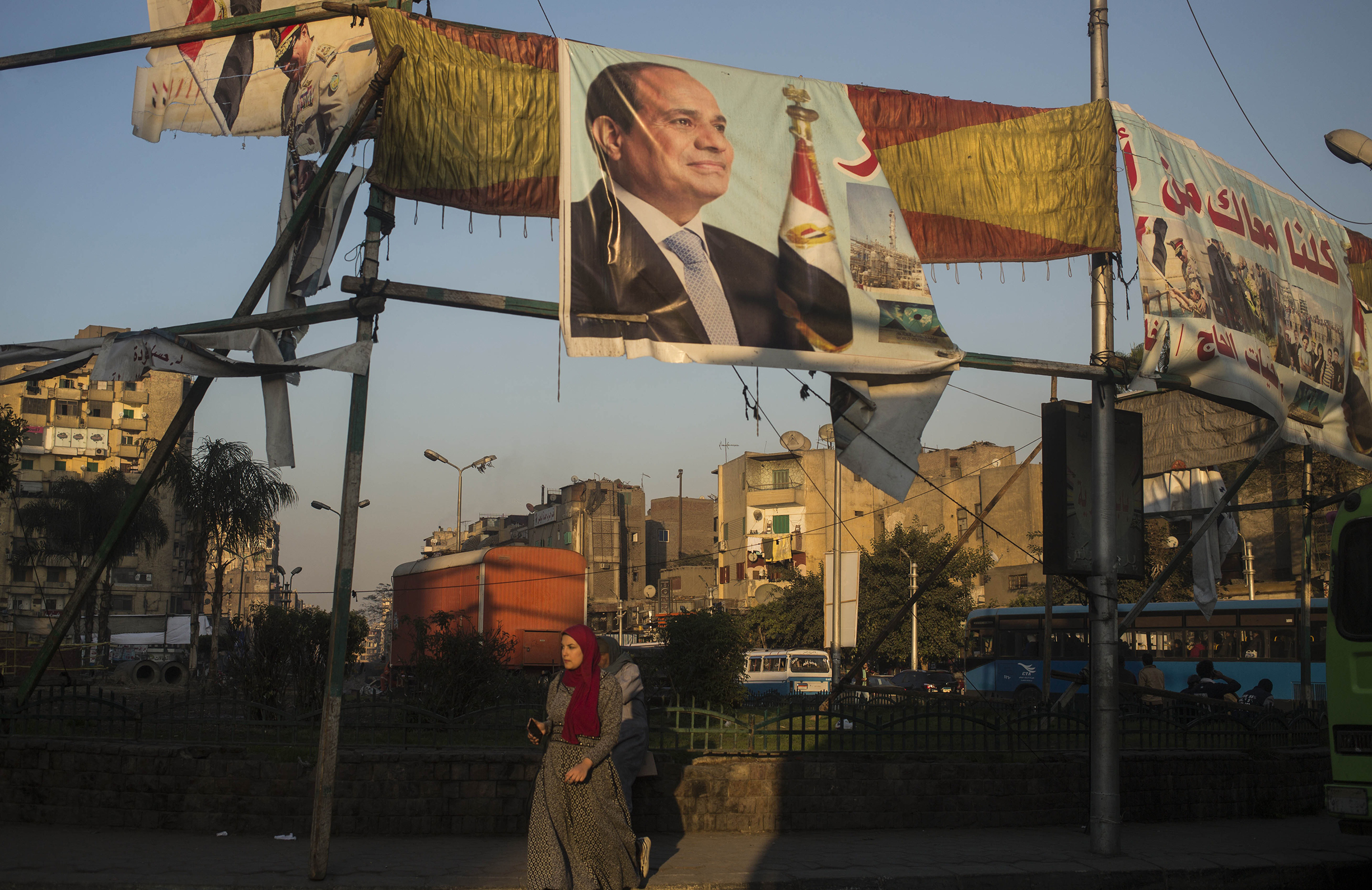 Genuine opposition candidates to Egyptian President Abdul Fattah al-Sisi, on poster above, have either been arrested or intimidated into dropping out
