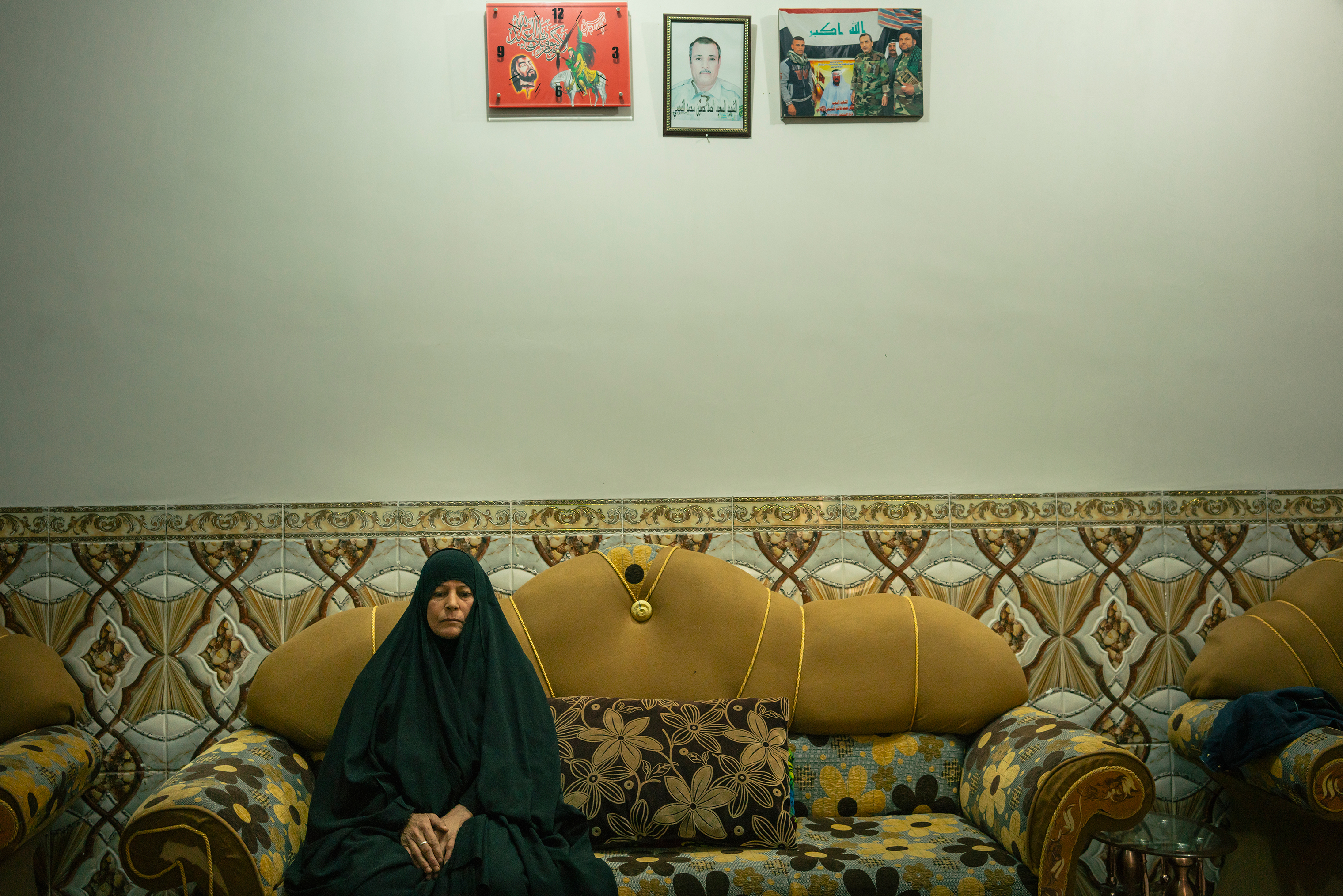 """Fatima Habib, 49, in her home in al-Zijalba. Her husband was killed fighting ISIS. Now she says her 16-year-old son has joined a local militia in case the jihadists return. """"He will avenge his father's death,"""" she says"""