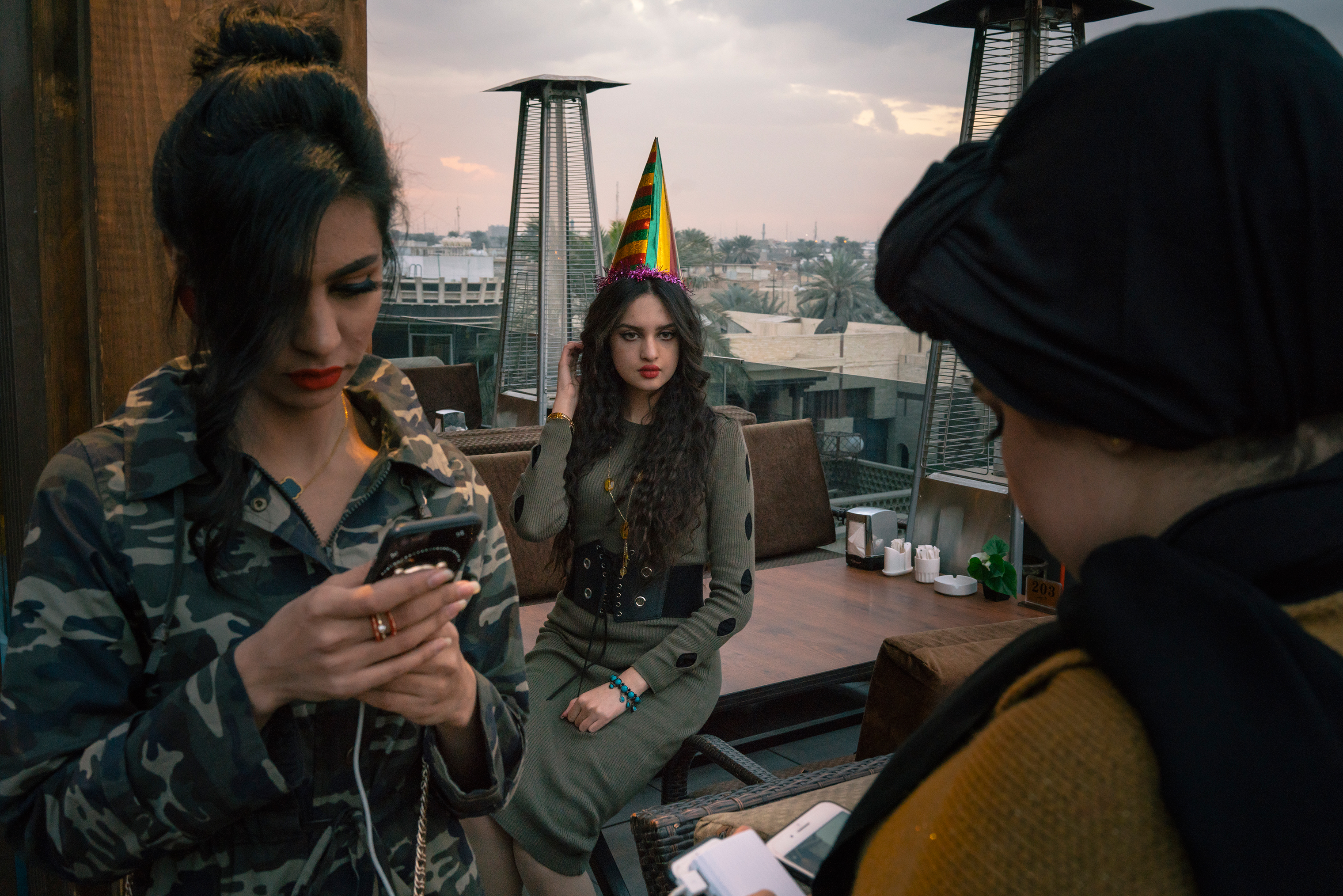 Nariman Abujahar, center, a computer engineering student, celebrates her 23rd birthday with friends on a restaurant's rooftop terrace in the Mansour district of Baghdad on Jan. 27.