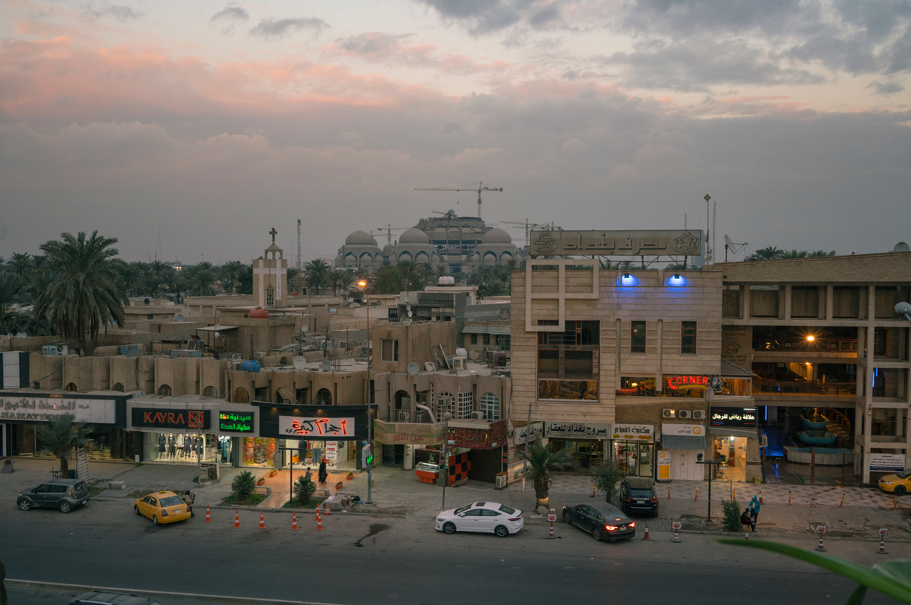 The uncompleted Al-Rahman Mosque, which was begun by Saddam Hussein but not finished due to the 2003 American invasion, rises above Baghdad's Mansour district on Jan. 27.