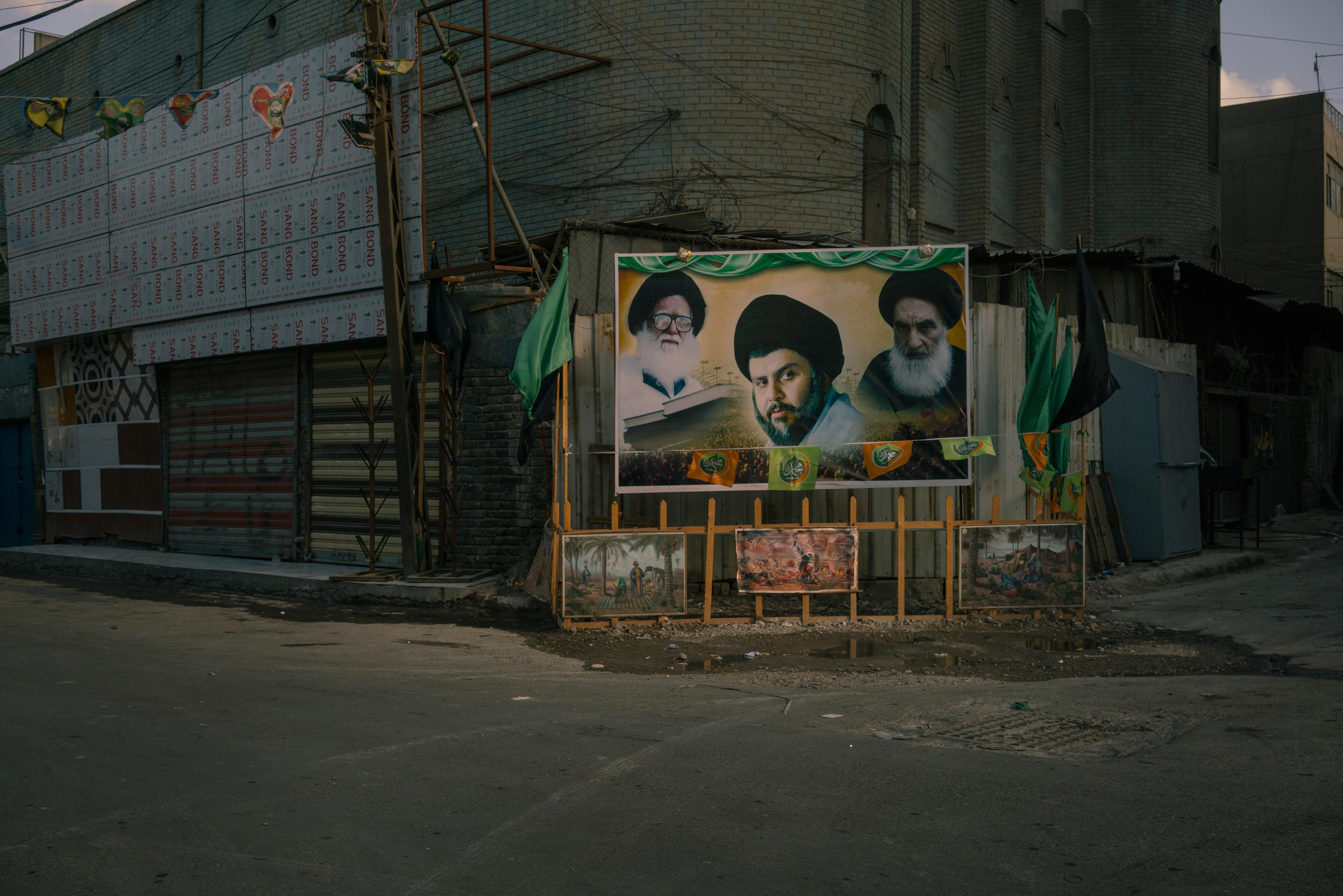 A billboard in Baghdad on Jan. 28 shows portraits of Shi'ite spiritual leaders, from left, Mohammad Sadeq al-Sadr, Muqtada al-Sadr and Ali al-Sistani.