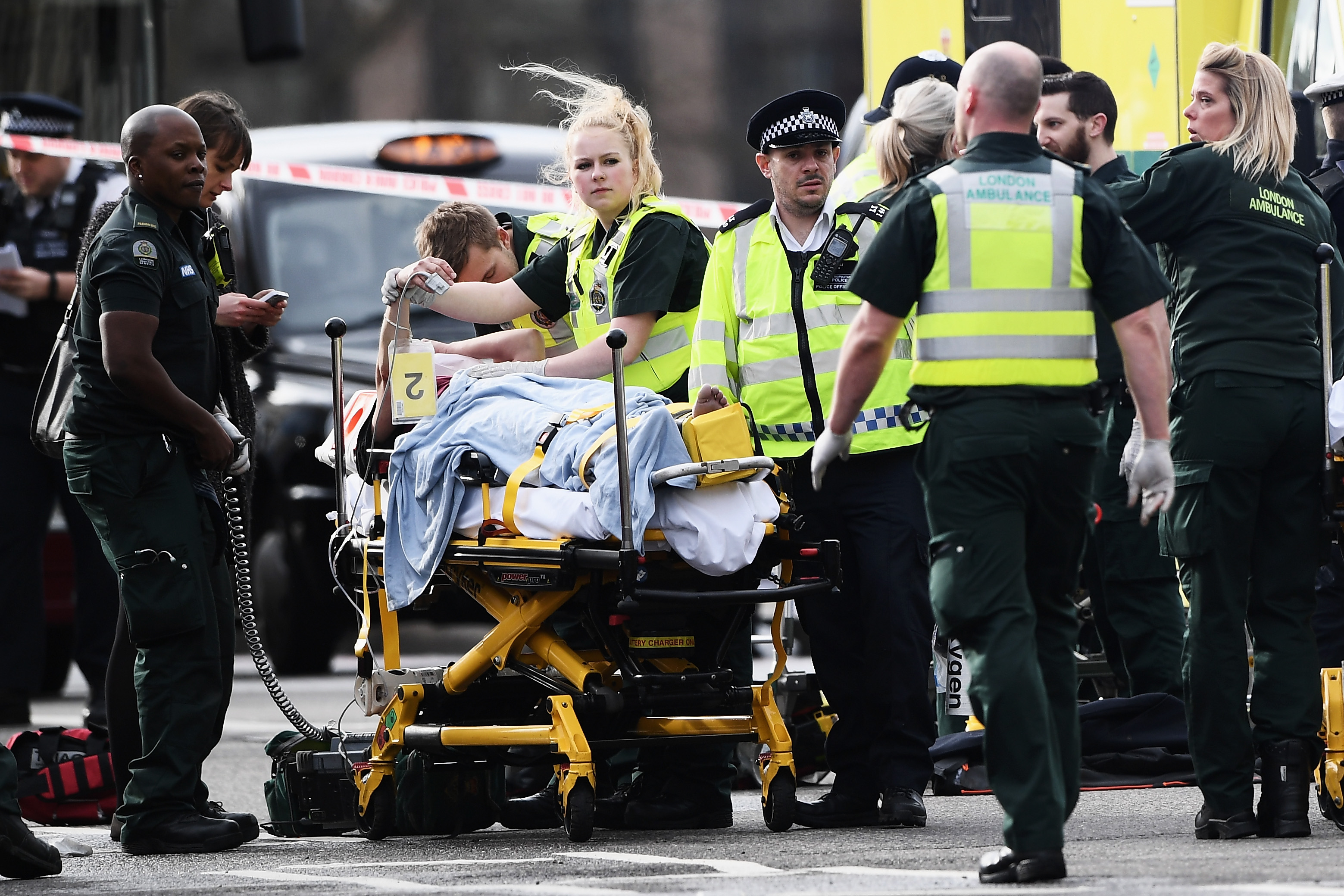 A member of the public is treated by emergency services near Westminster Bridge and the Houses of Parliament on March 22, 2017 in London, England.