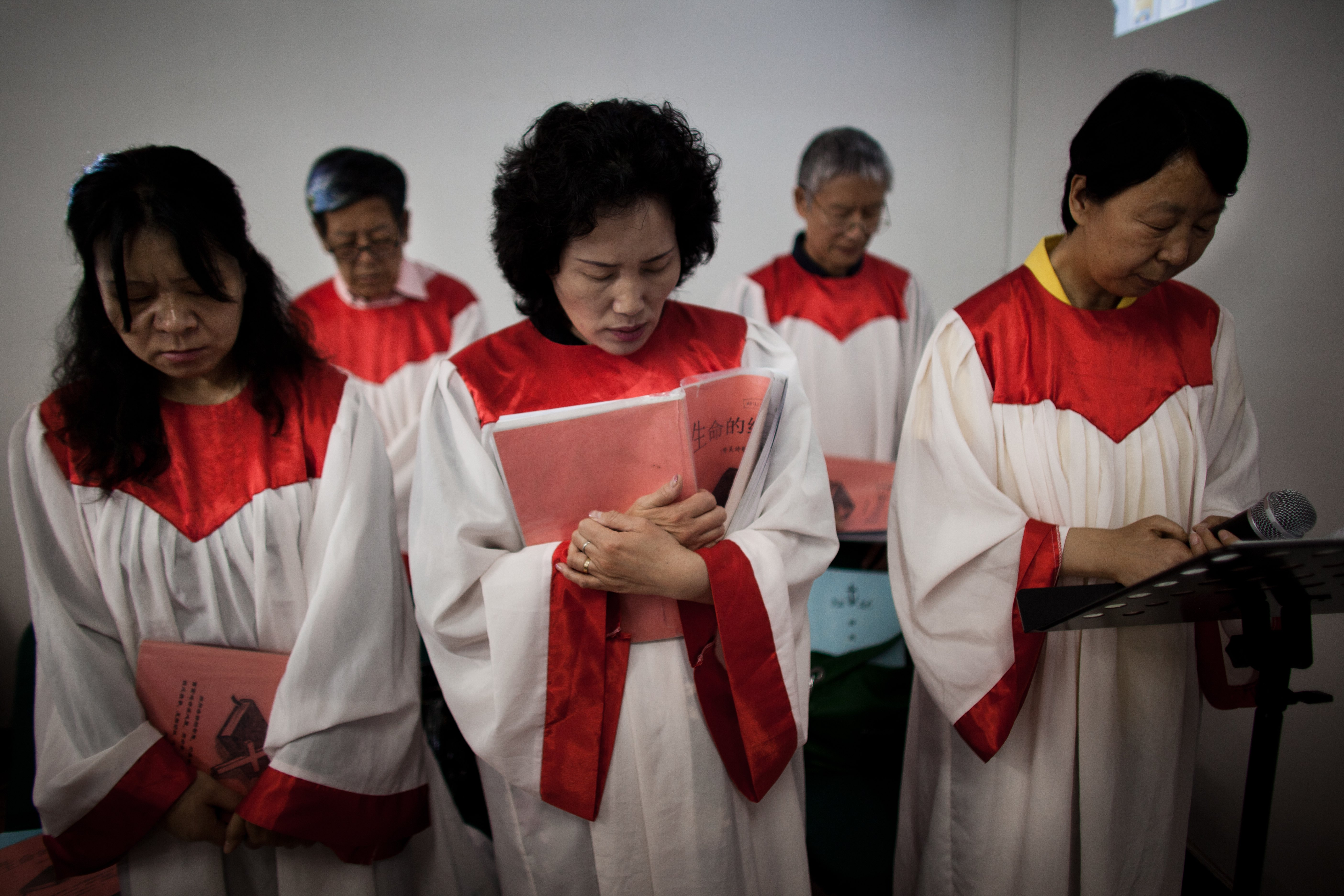 Members of a house church meet for Sunday service May 15, 2011 in Beijing, China.