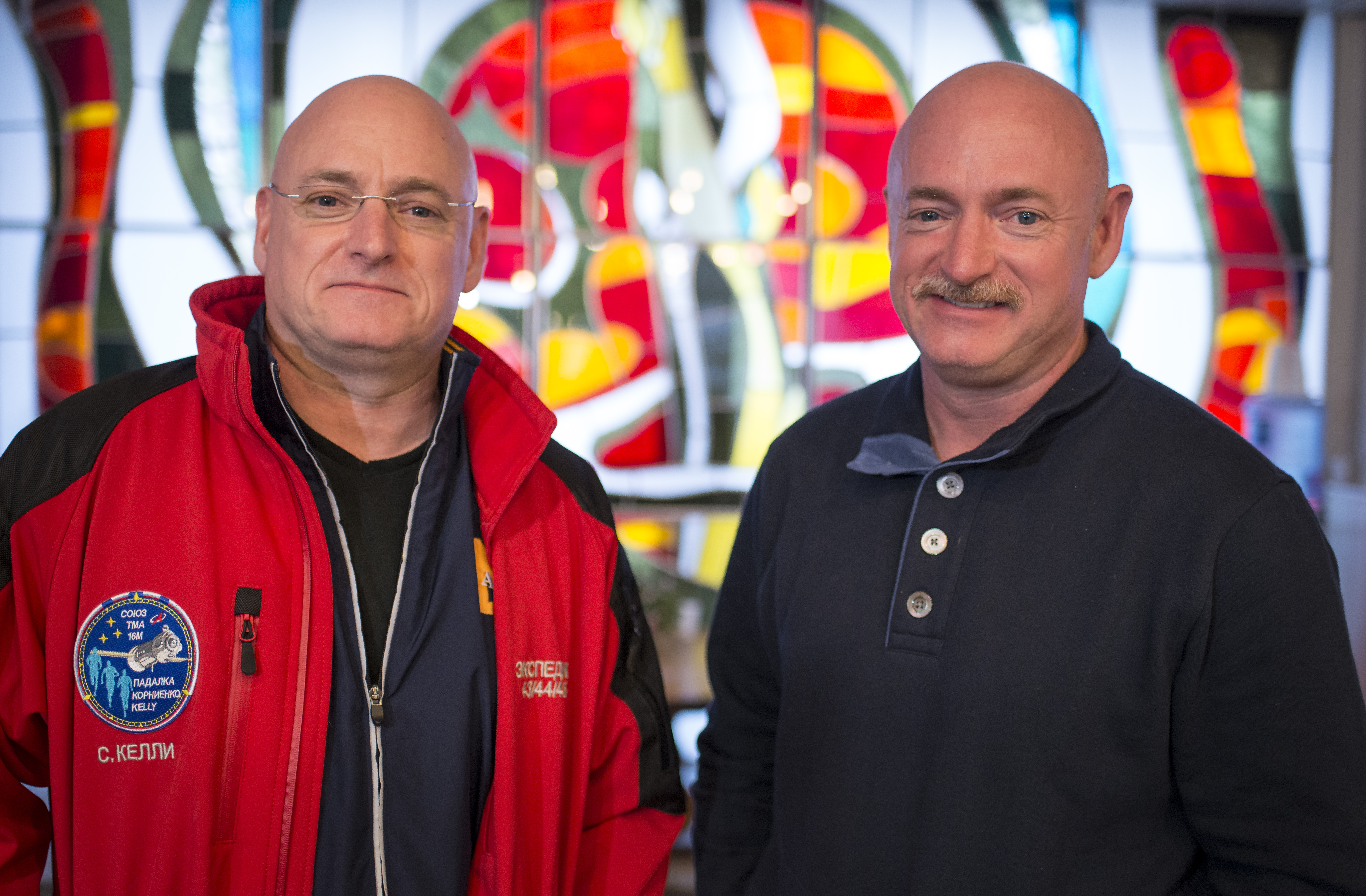 Expedition 43 NASA Astronaut Scott Kelly, left, and his identical twin brother Mark Kelly, pose for a photograph Thursday, March 26, 2015 at the Cosmonaut Hotel in Baikonur, Kazakhstan. Scott Kelly, and Russian Cosmonauts Mikhail Kornienko, and Gennady Padalka of the Russian Federal Space Agency (Roscosmos) are scheduled to launch to the International Space Station in the Soyuz TMA-16M spacecraft from the Baikonur Cosmodrome in Kazakhstan March 28, Kazakh time (March 27 Eastern time.) As the one-year crew, Kelly and Kornienko will return to Earth on Soyuz TMA-18M in March 2016.