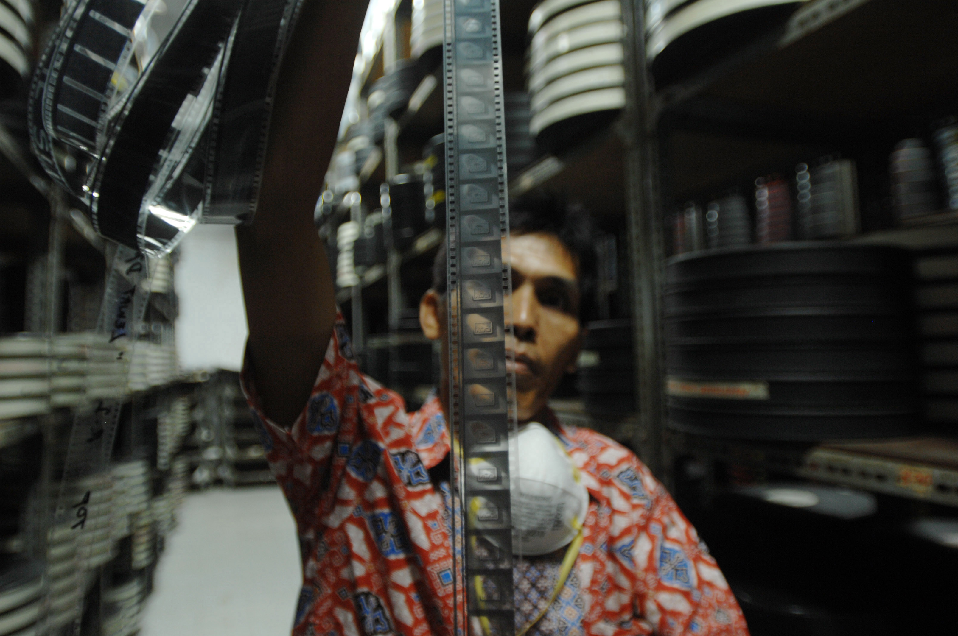 A film archivist holds up a film roll in the storage room at the Usmar Ismail Building in Jakarta, Indonesia on Oct. 28, 2016.
