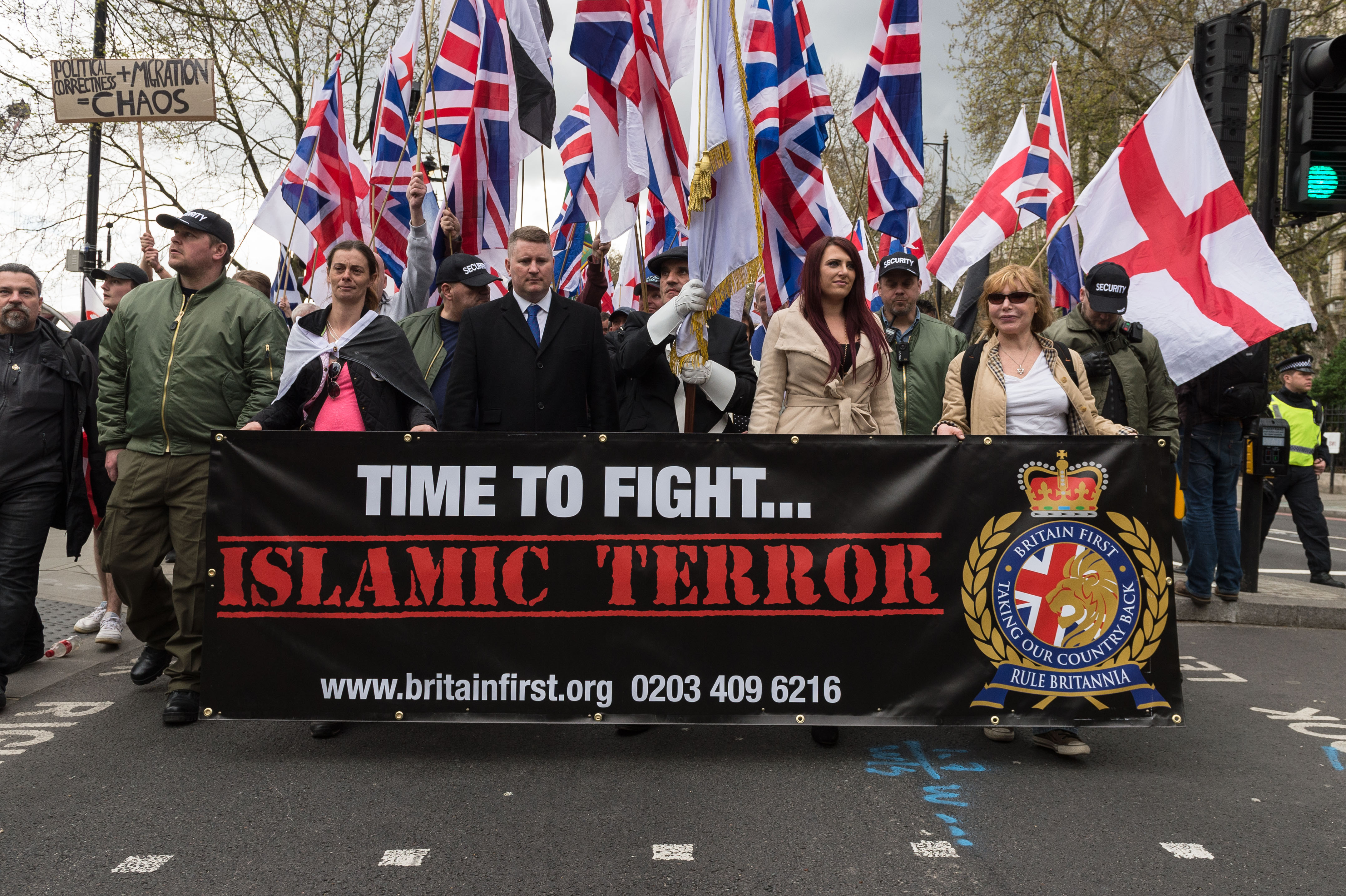 Britain First leaders Jayda Fransen (2R) and Paul Golding (3L) lead March Against Terrorism on April 01, 2017 in London, England.