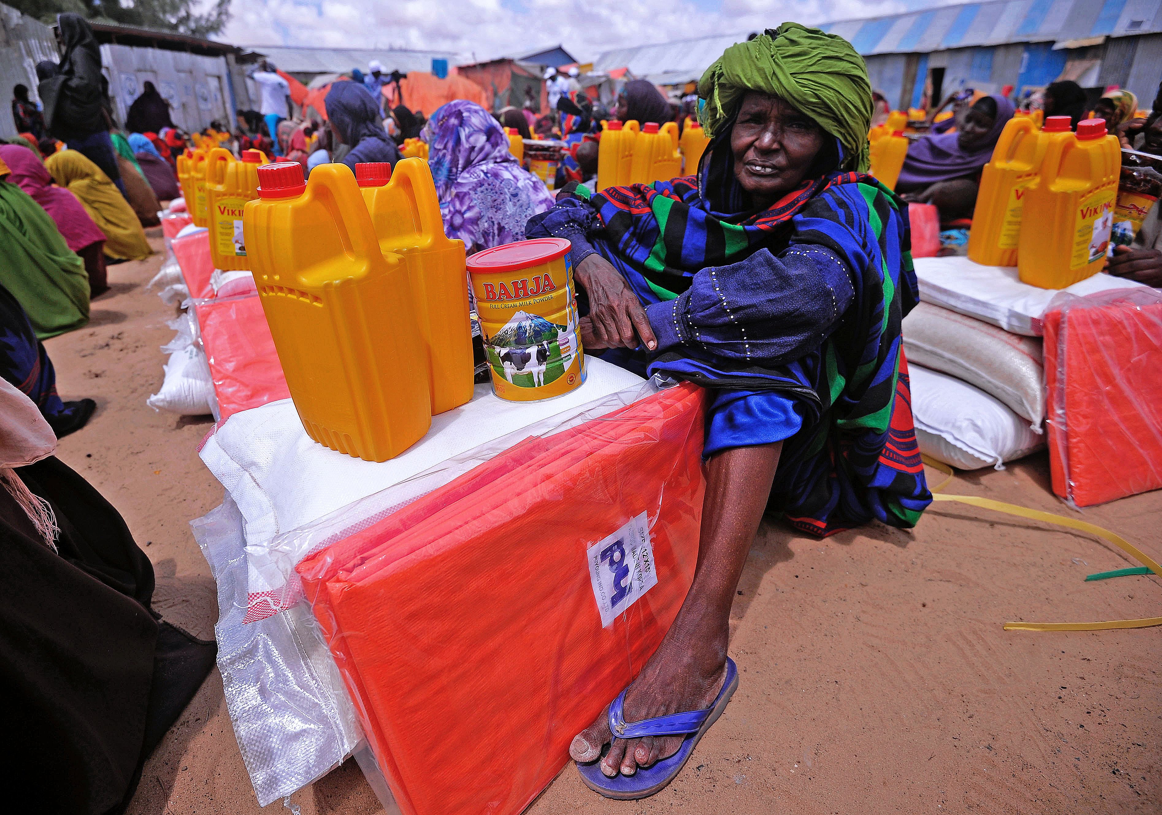 A Somali woman displaced by drought waits for food and water at an aid distribution centre outside Mogadishu on April 6, 2017.