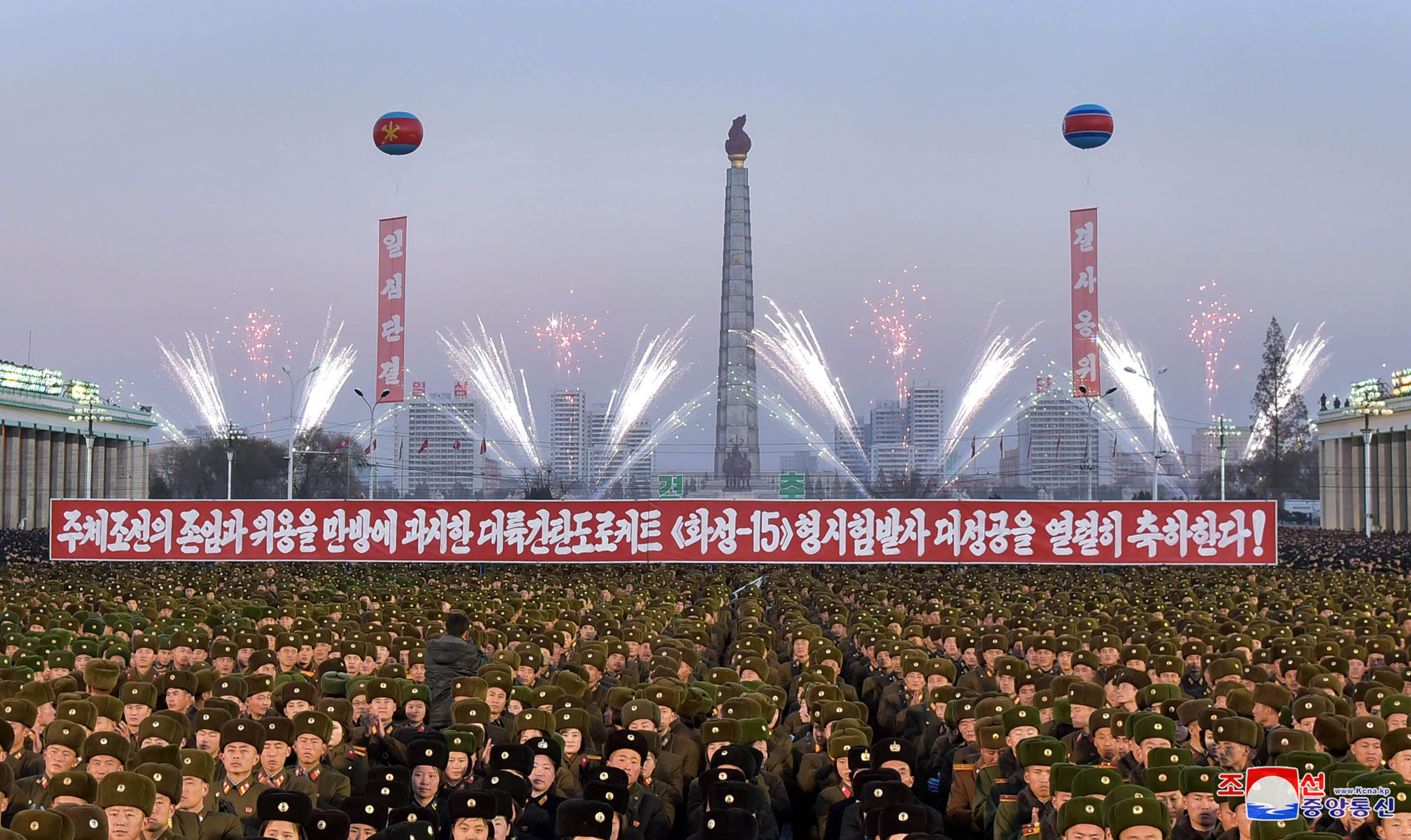 This picture released by North Korea's official Korean Central News Agency on Dec. 2, 2017 shows North Korean soldiers and residents holding a rally in Pyongyang.