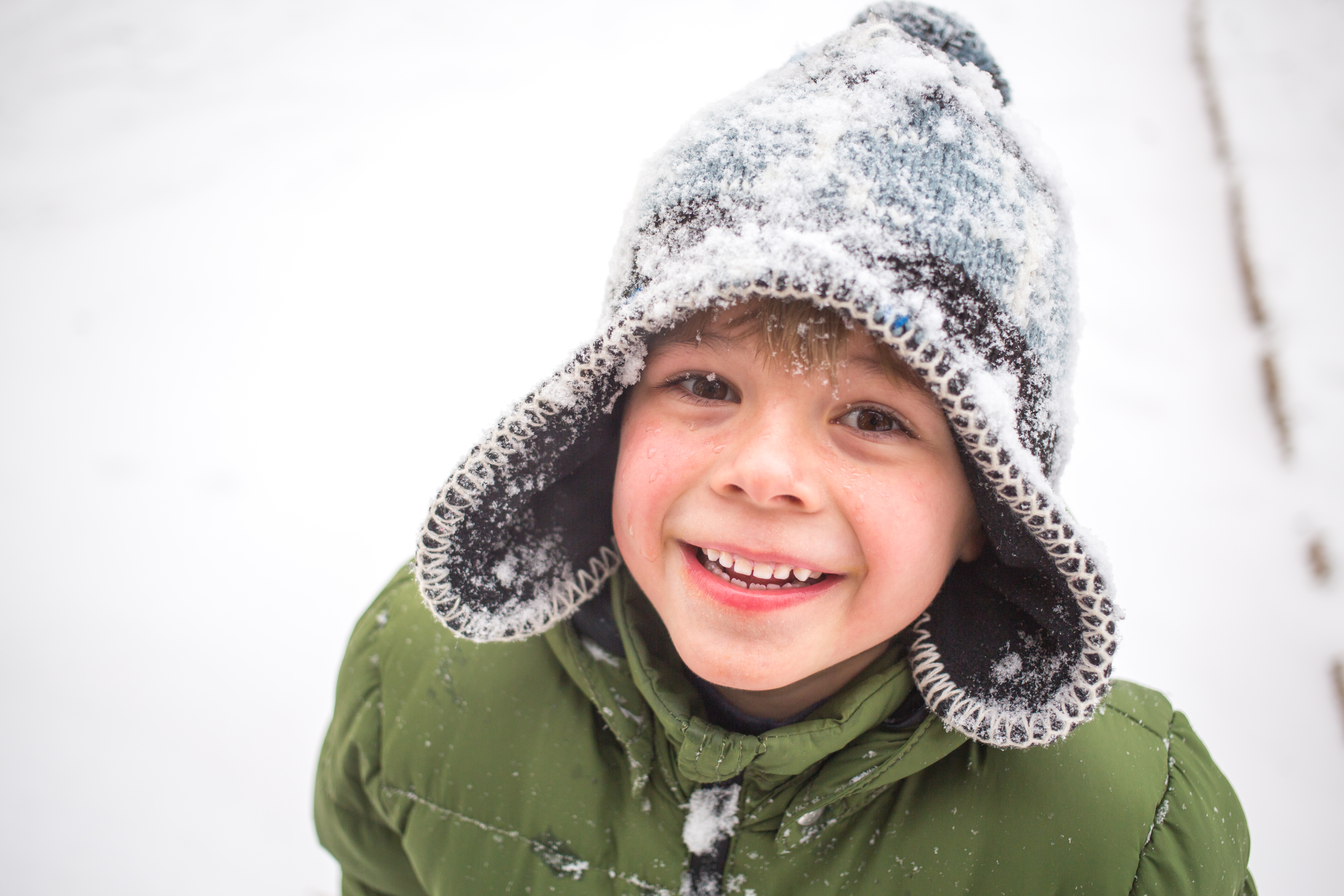 A boy plays in the snow in Finland.