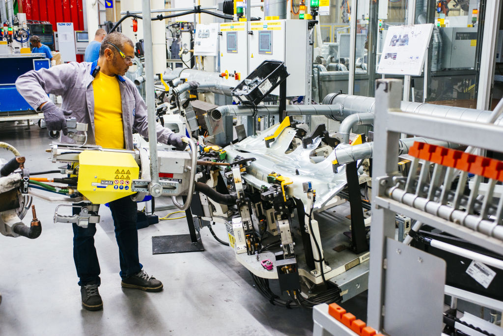 A worker uses machinery to work on bodywork for VW Polo automobiles on the production line at the Volkswagen AG plant in Uitenhage, South Africa, on Thursday, Jan. 25, 2018. Growth in European car sales will slow after reaching a 10-year high last year, an industry group said, as consumer worries about Brexit and future regulations on auto emissions curtail purchases. Photographer: Waldo Swiegers /Bloomberg via Getty Images