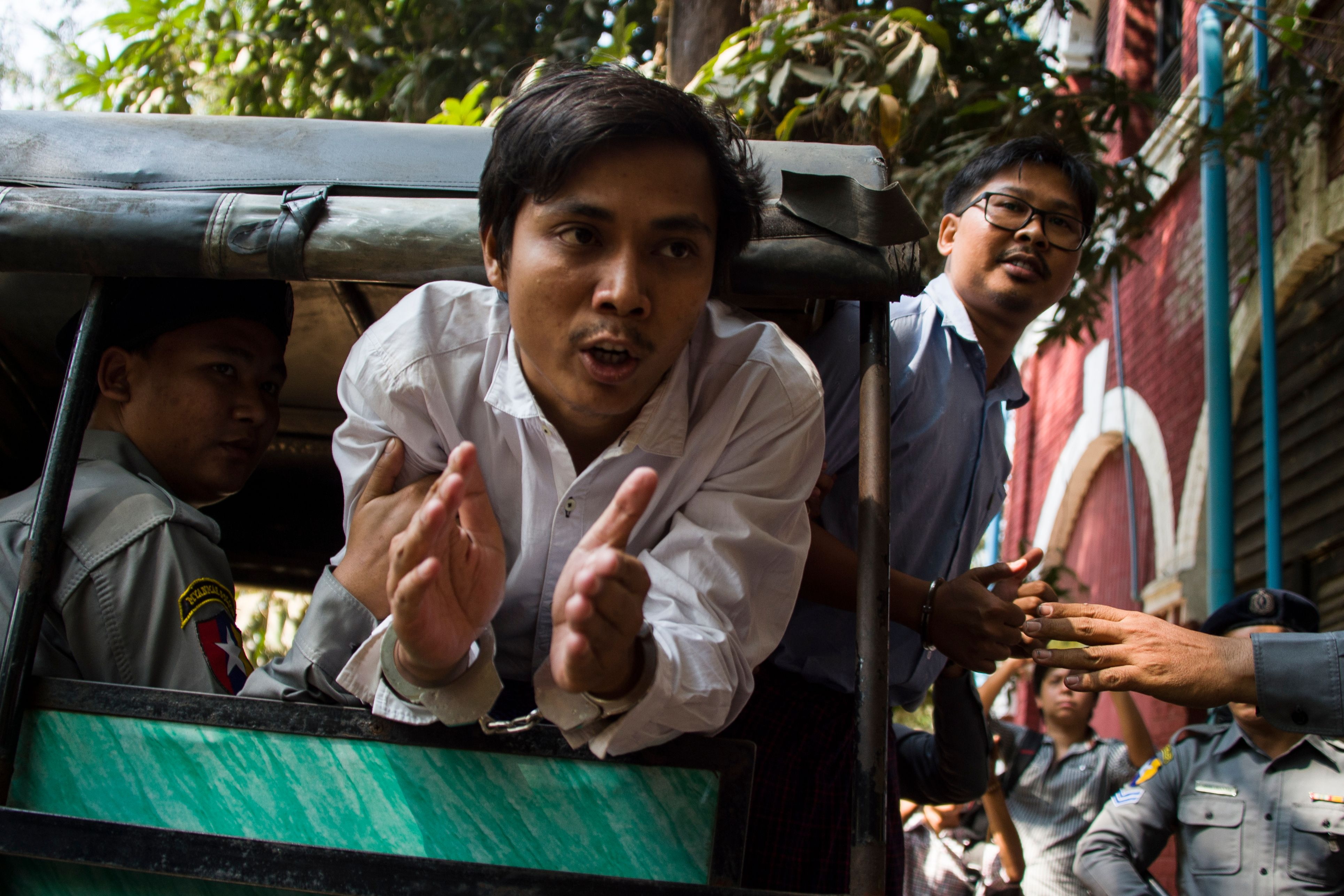 Detained Reuters journalists Kyaw Soe Oo  and Wa Lone talk to the media as they are taken from court in Yangon, Myanmar on Feb. 14, 2018.