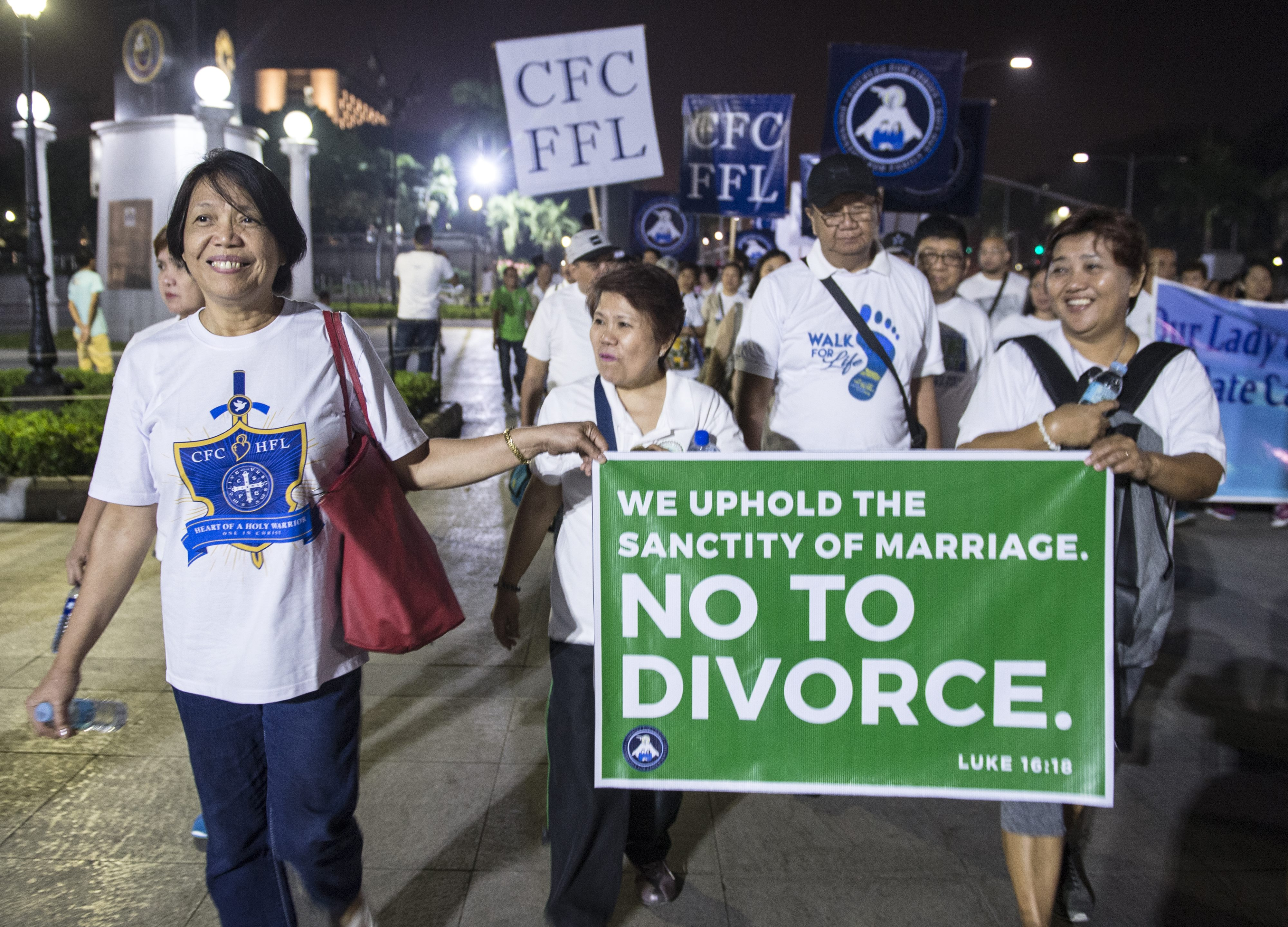 Catholic protestors carry signs at a  march for life  to oppose a bill legalizing divorce in Manila, Philippines on Feb. 24, 2018.
