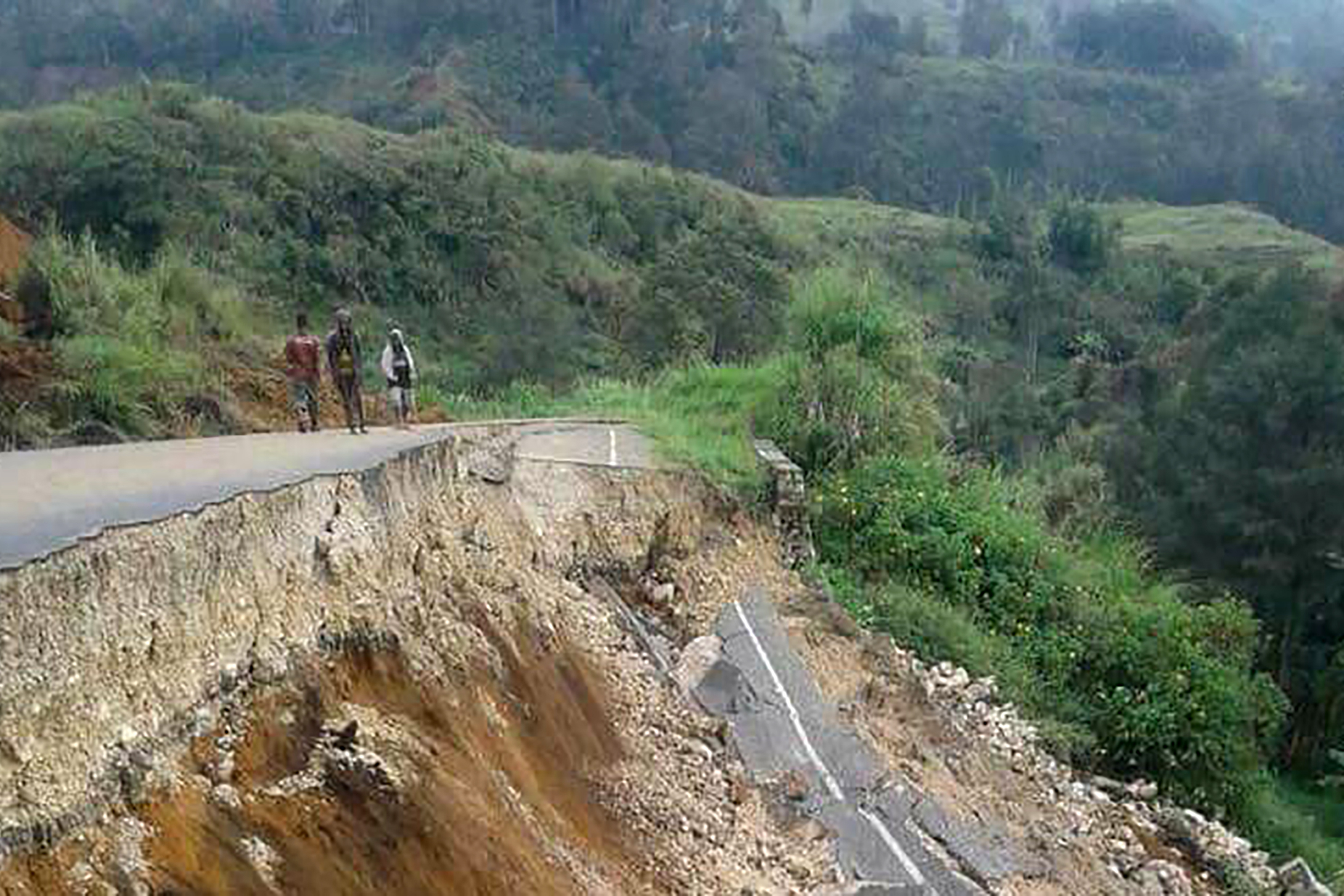 This photo taken on Feb. 27, 2018 shows damage to a road near Mendi in Papua New Guinea's highlands region after a 7.5-magnitude earthquake.