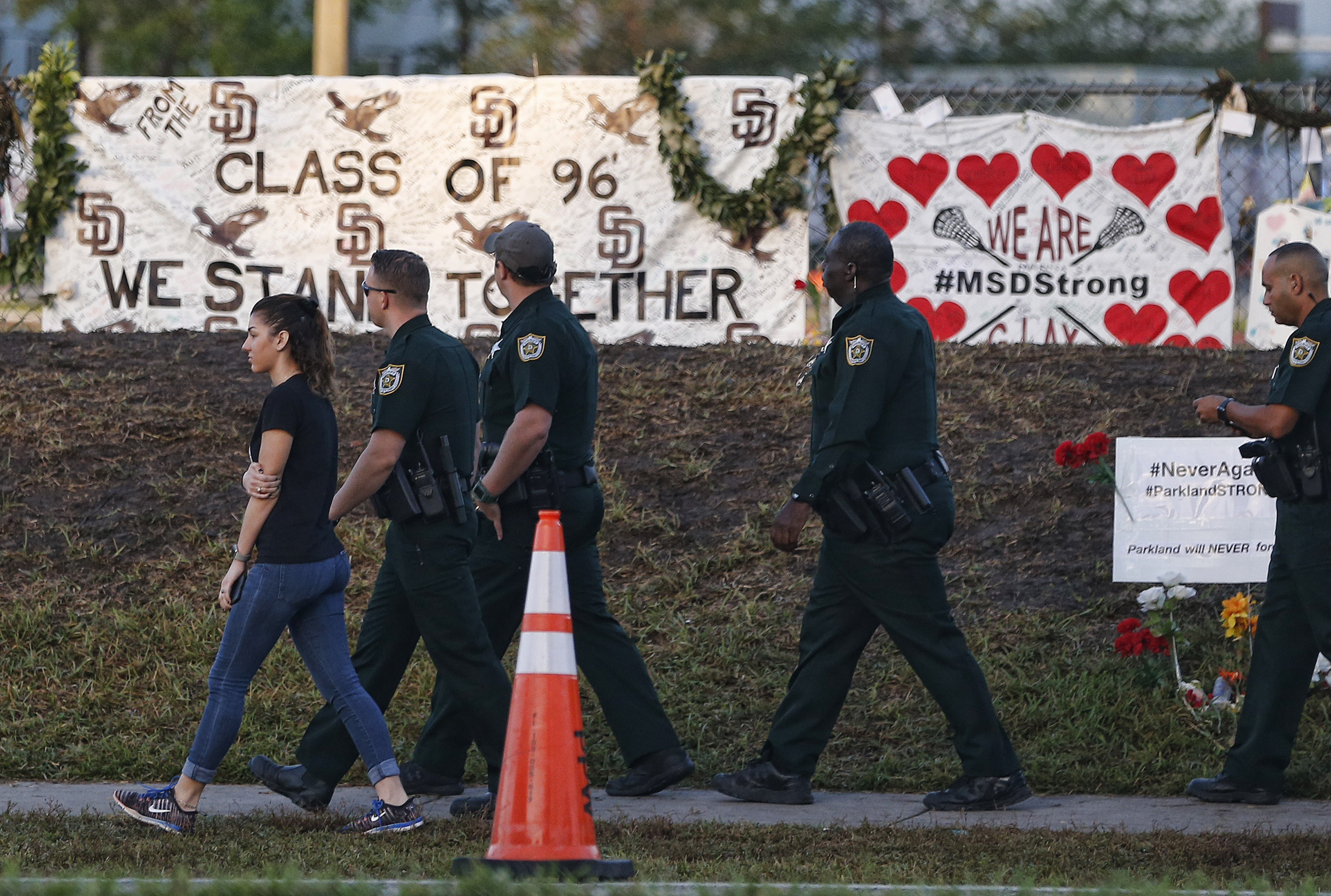 Marjory Stoneman Douglas High School staff, teachers and students return to school greeted by police and well wishers in Parkland, Florida on Feb. 28, 2018.