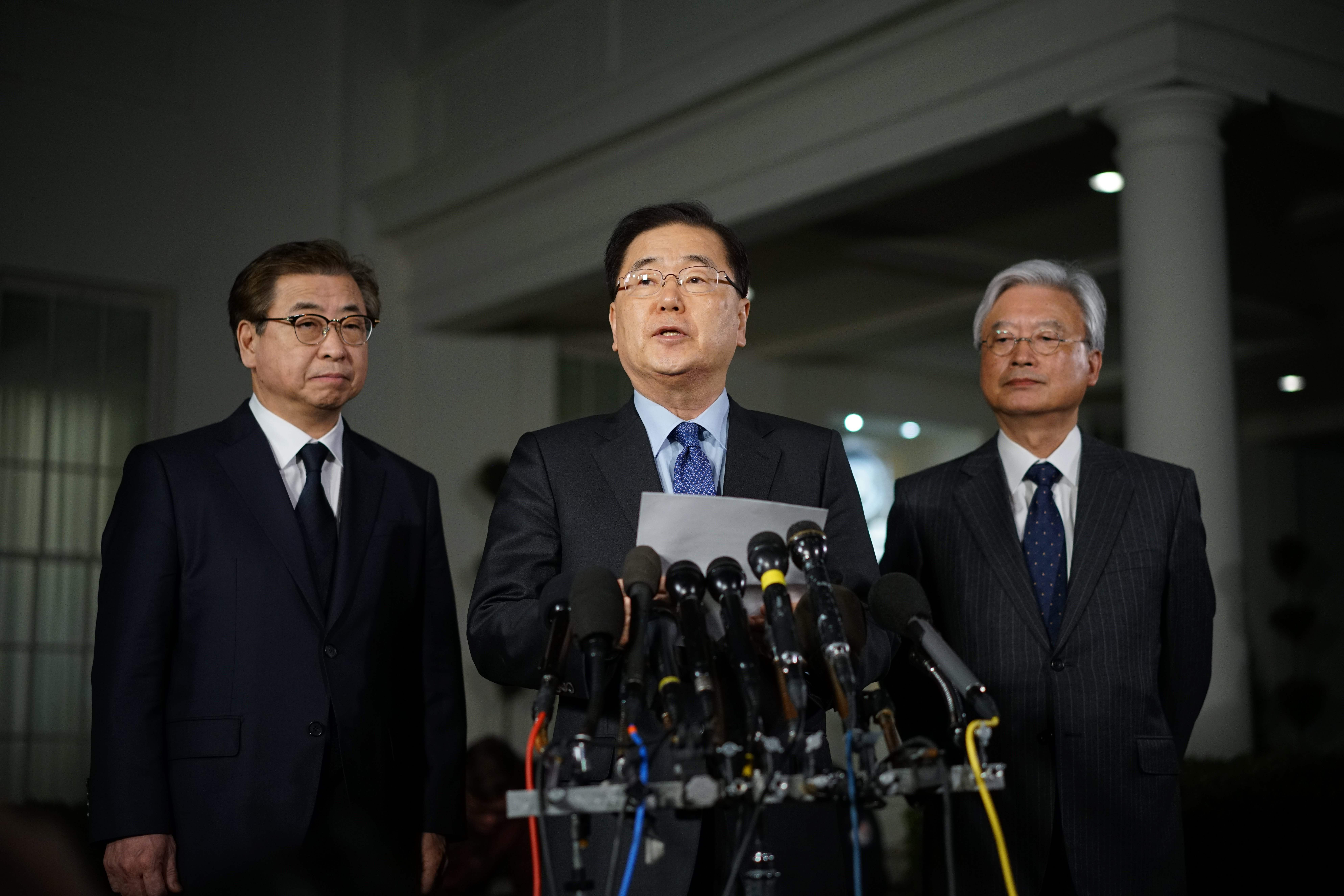 South Korean National Security Advisor Chung Eui-yong flanked by South Korea National Intelligence Service chief Suh Hoon (L) and South Korea's ambassador to the United States Cho Yoon-je (R), outside the West Wing of the White House on March 8, 2018 in Washington, DC.