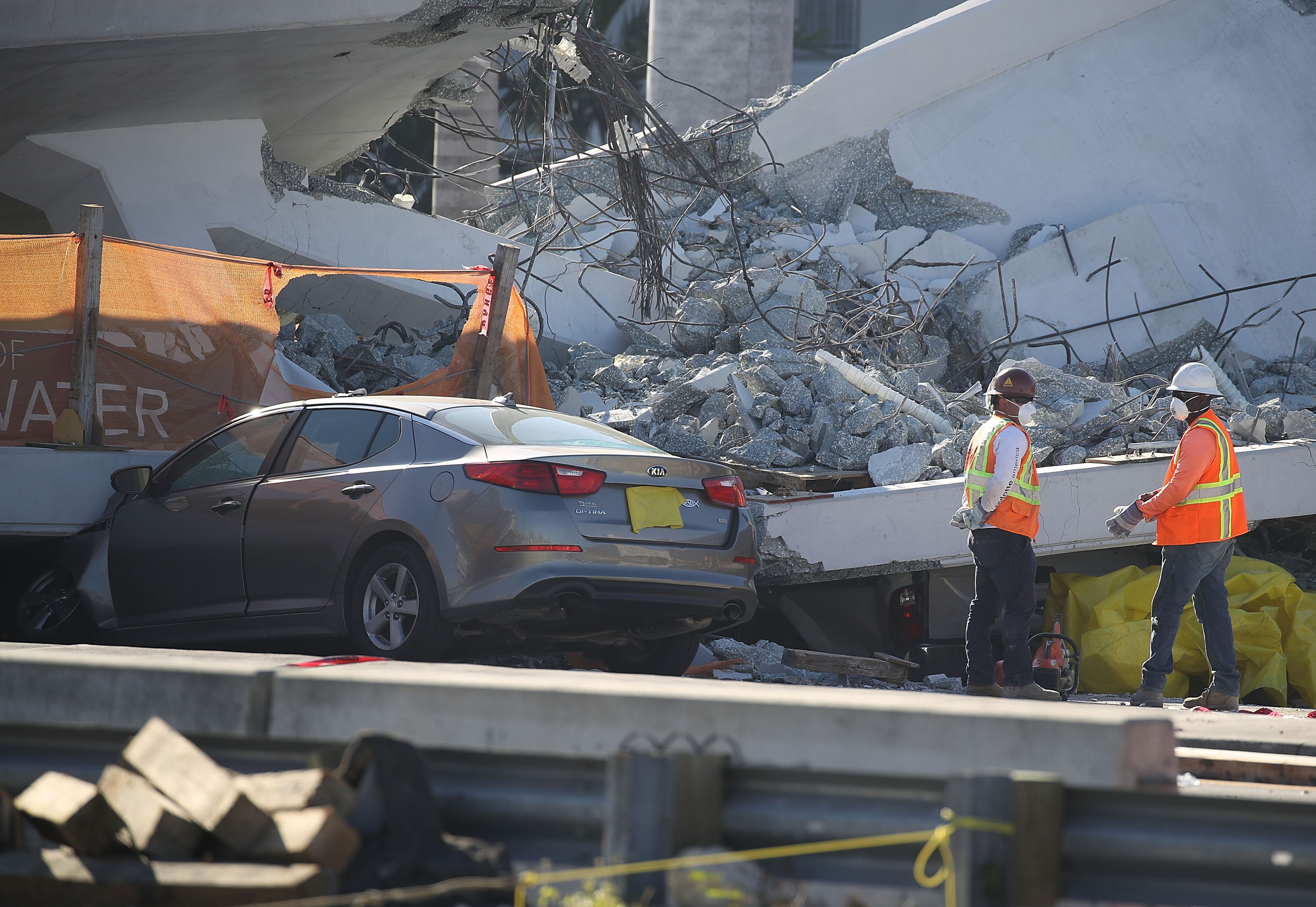 Workers, law enforcement and members of the National Transportation Safety Board investigate the scene where a pedestrian bridge collapsed a few days after it was built over southwest 8th street allowing people to bypass the busy street to reach Florida International University on March 16, 2018 in Miami, Florida.