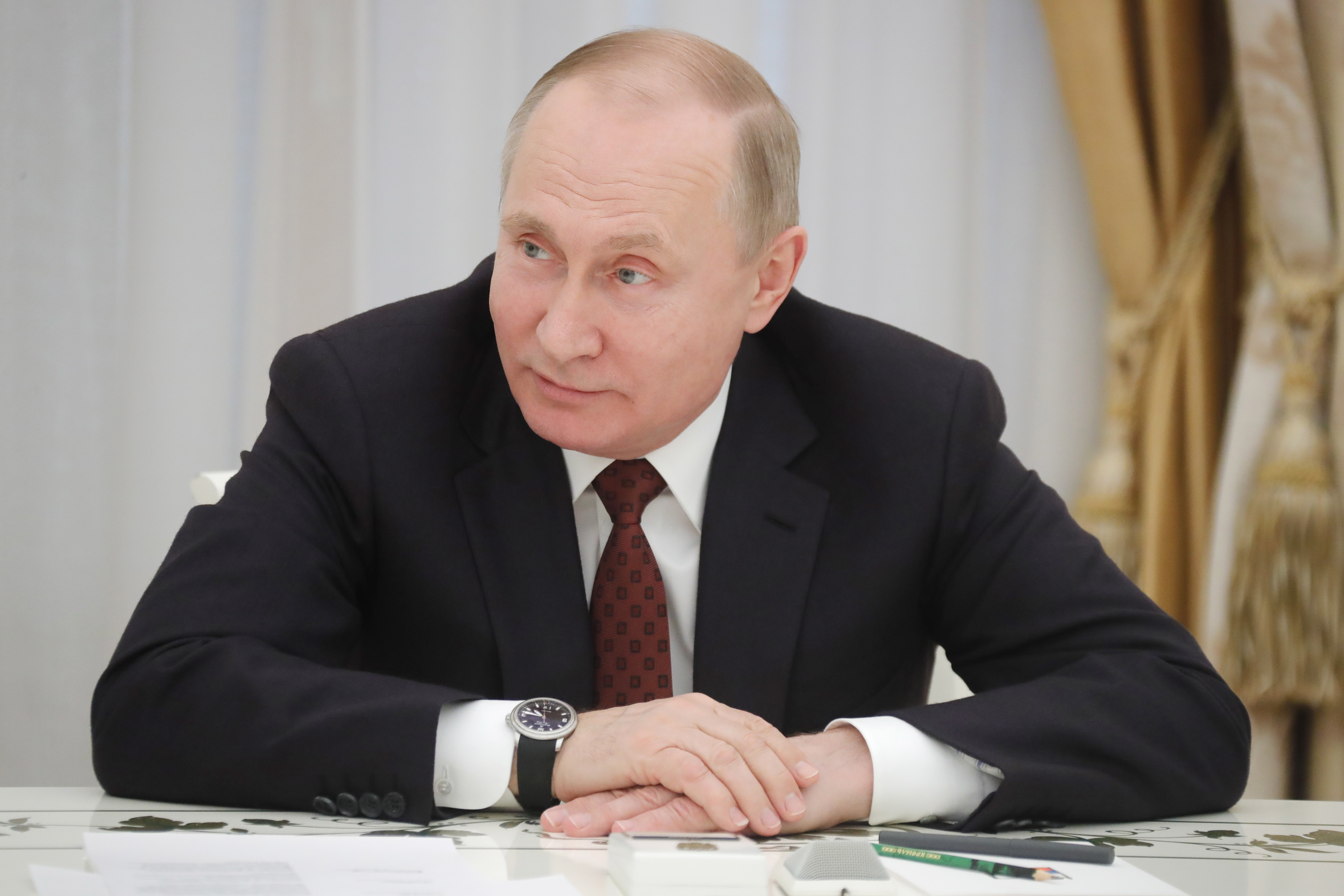 Russia's President Vladimir Putin meets with candidates in the 2018 Russian presidential election at Moscow's Kremlin.