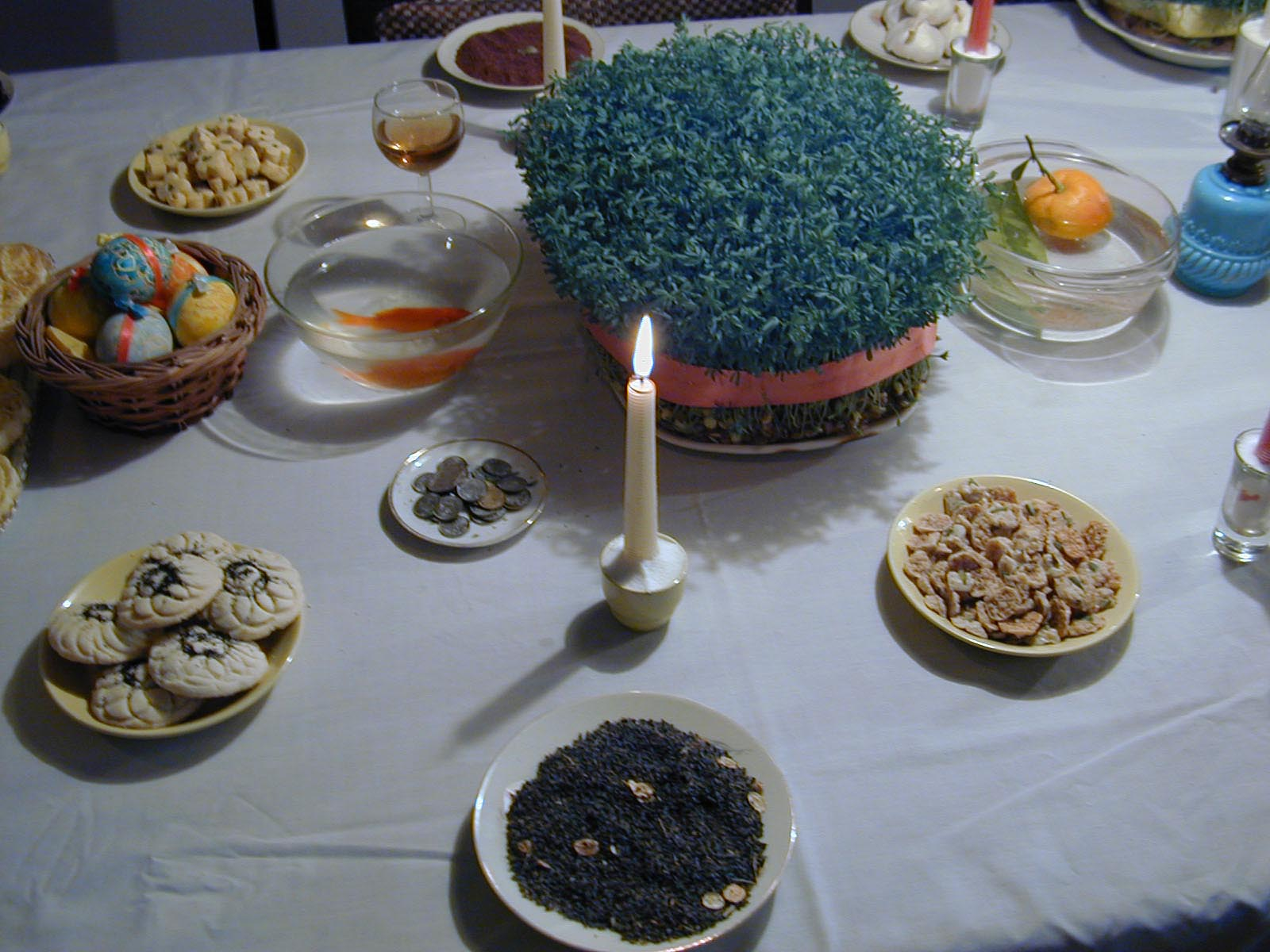 A Haft-Sin table furnished with the traditional seven symbolic items, each beginning with the Persian letter S (Sin), Tehran, Iran, 21st March 2002. Haft-Sin is a tradition associated with Iranian new year (Nowruz) celebrations. (Photo by Kaveh Kazemi/Getty Images)