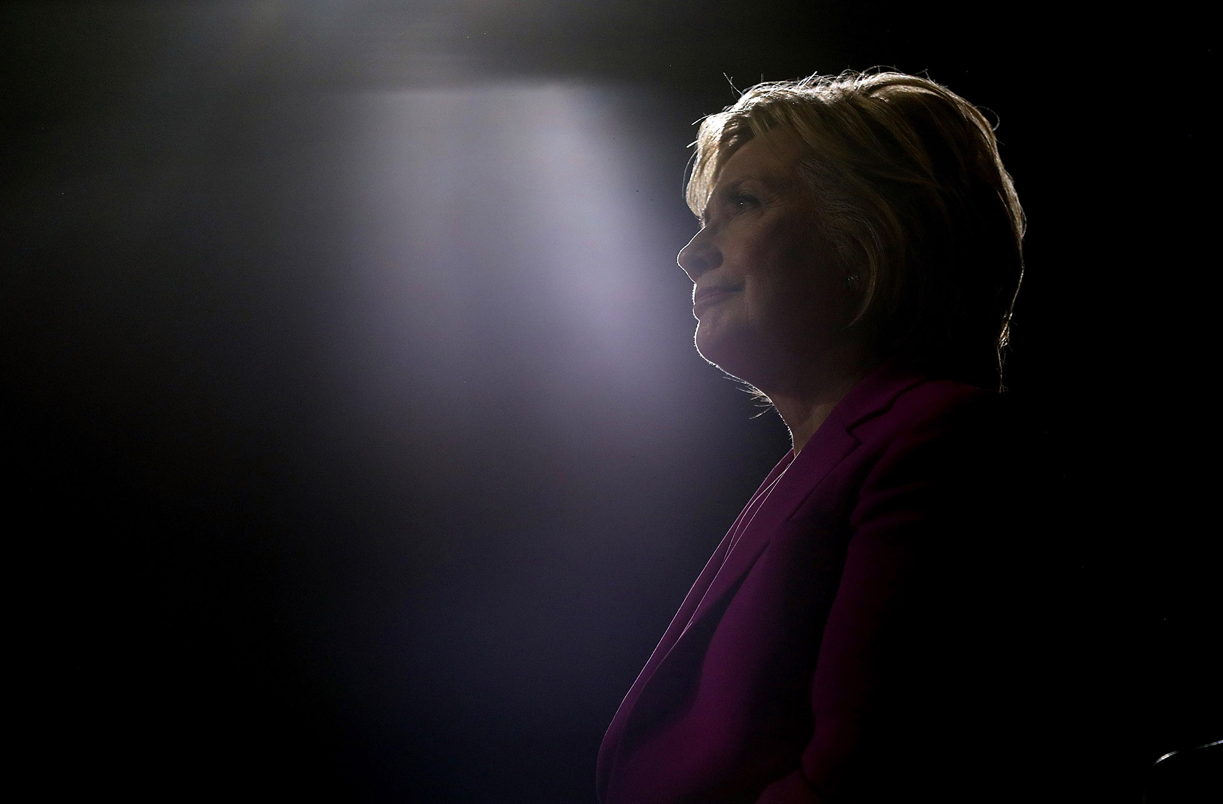 Democratic presidential candidate State Hillary Clinton looks on as president Barack Obama speaks during a campaign rally in Charlotte, N.C., on July 5, 2016.