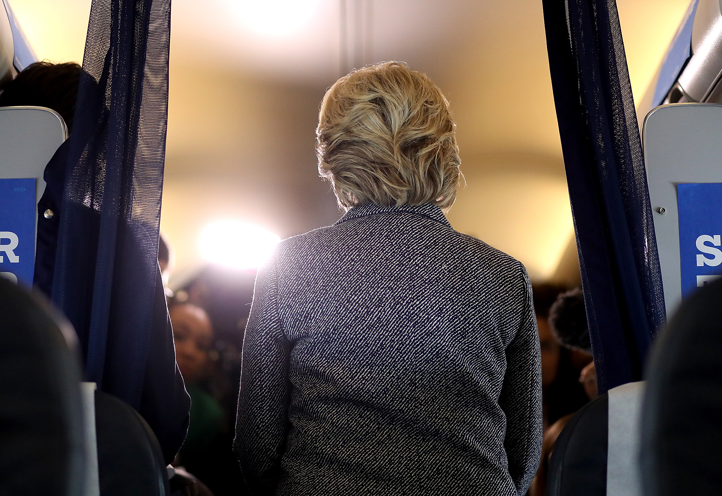 Democratic presidential nominee Hillary Clinton speaks to reporters aboard her campaign plane at Chicago Midway Airport on Sept. 29, 2016.
