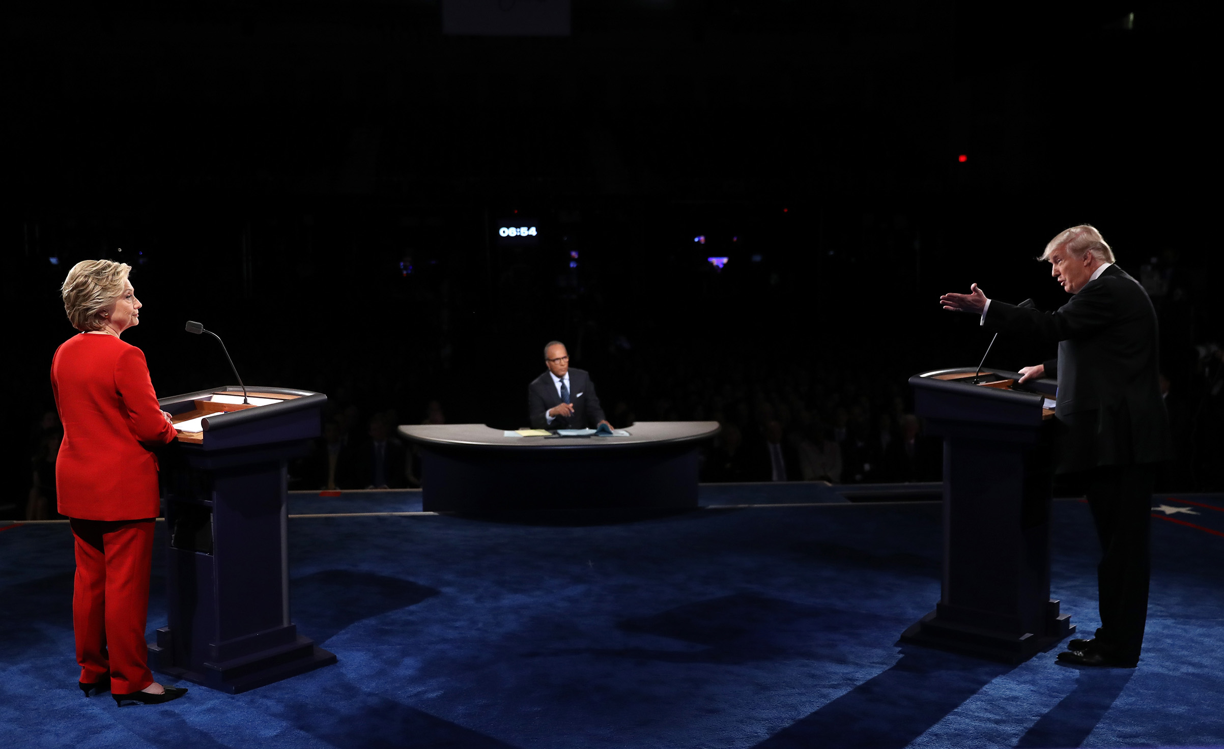 Republican presidential nominee Donald Trump speaks as Democratic presidential nominee Hillary Clinton and Moderator Lester Holt listens during the Presidential Debate at Hofstra University on Sept. 26, 2016.