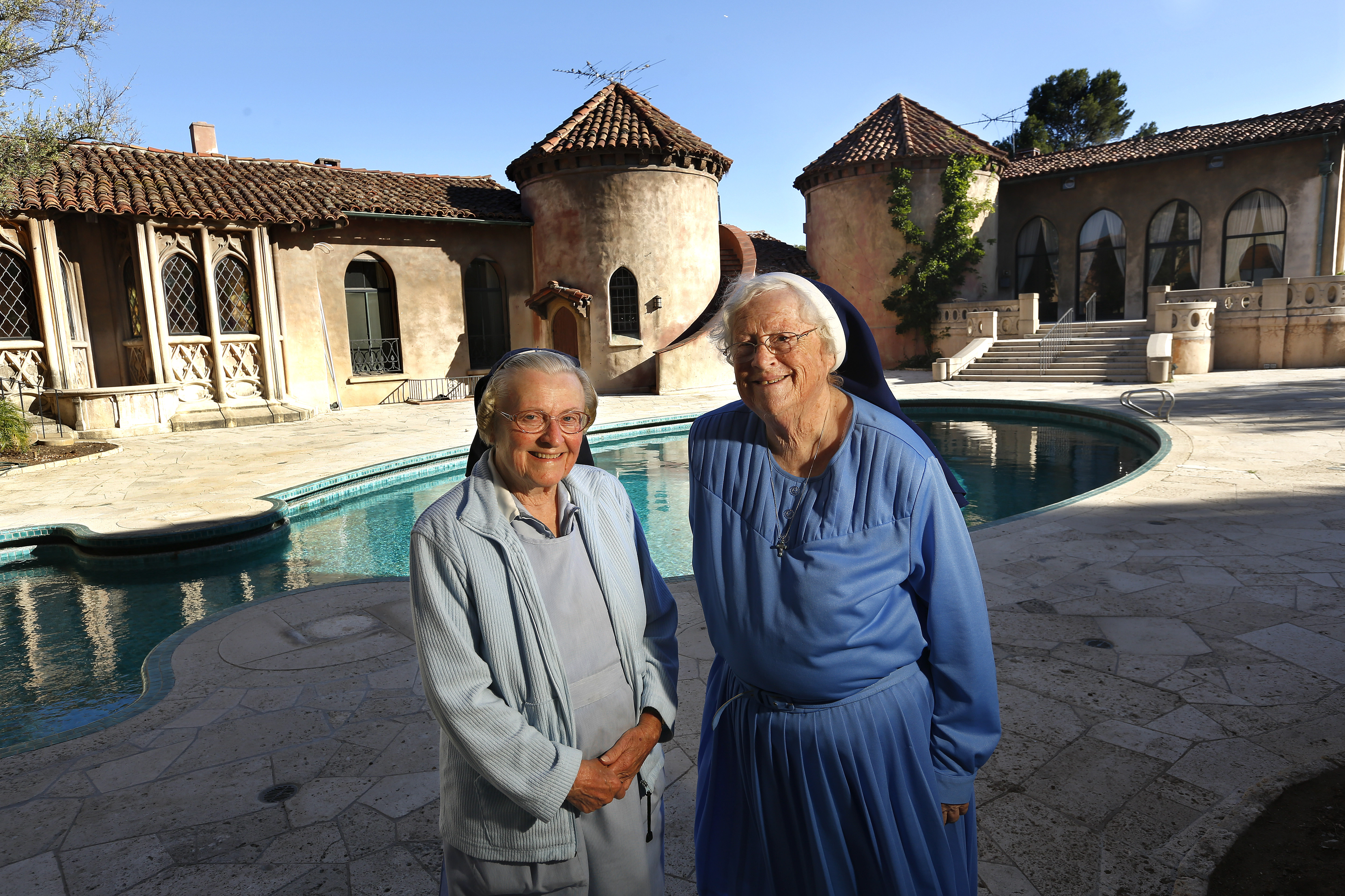 Sister Catherine Rose (L) and Sister Rita Callanan (77) stand outside the Sisters of the Immaculate Heart of Mary Retreat House on June 25, 2015 in in Los Feliz, California.  The Sisters of the Immaculate Heart recently sold their property to restaurateur Dana Hollister, but the Archdiocese of Los Angeles has argued that only they have the authority to sell the property, and plan to sell it to singer Katy Perry.