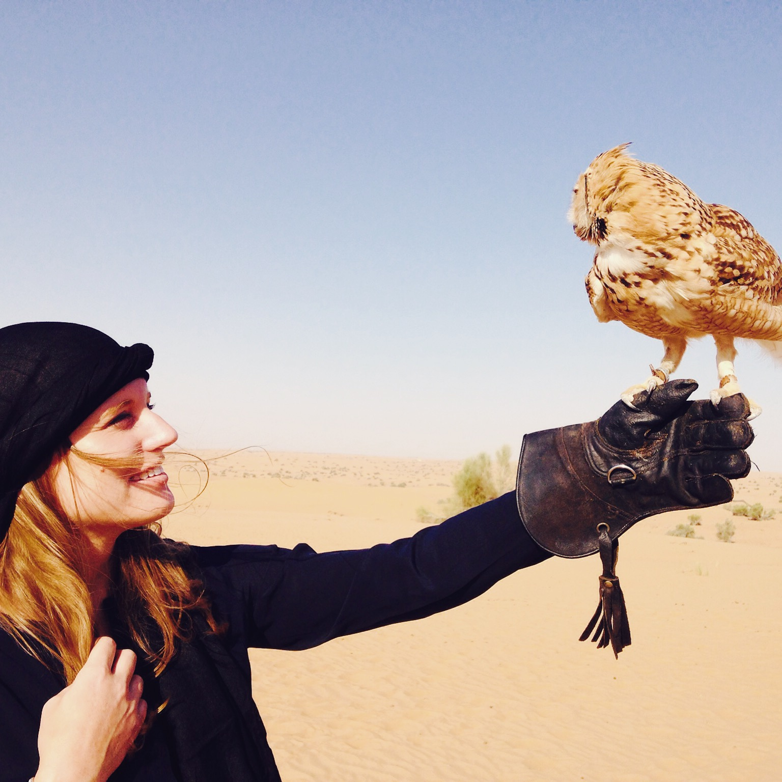 Katherine Conaway at a falconry tour in the desert outside of Dubai