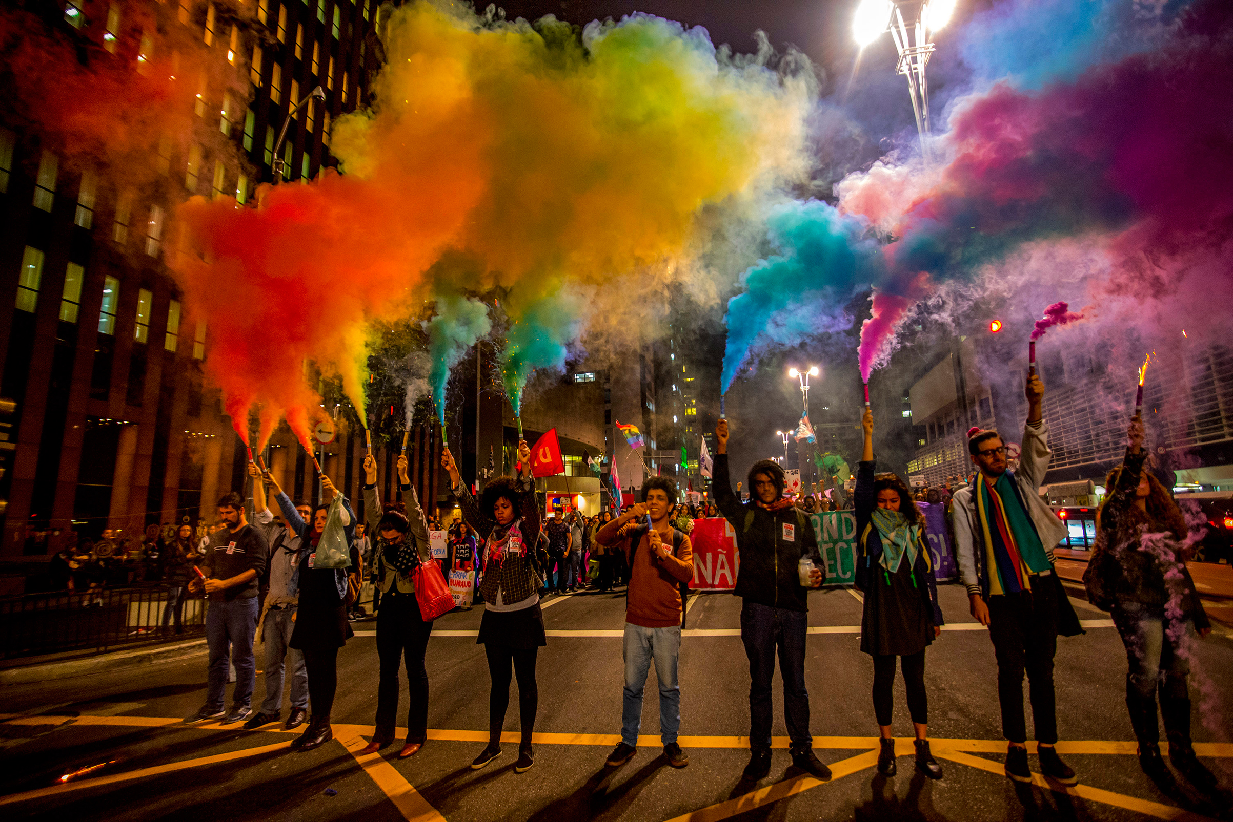 People attend a vigil in front of the Masp in Sao Paulo, Brazil on June 15, 2016, in reaction to the mass shooting at a gay nightclub in Orlando, Florida.