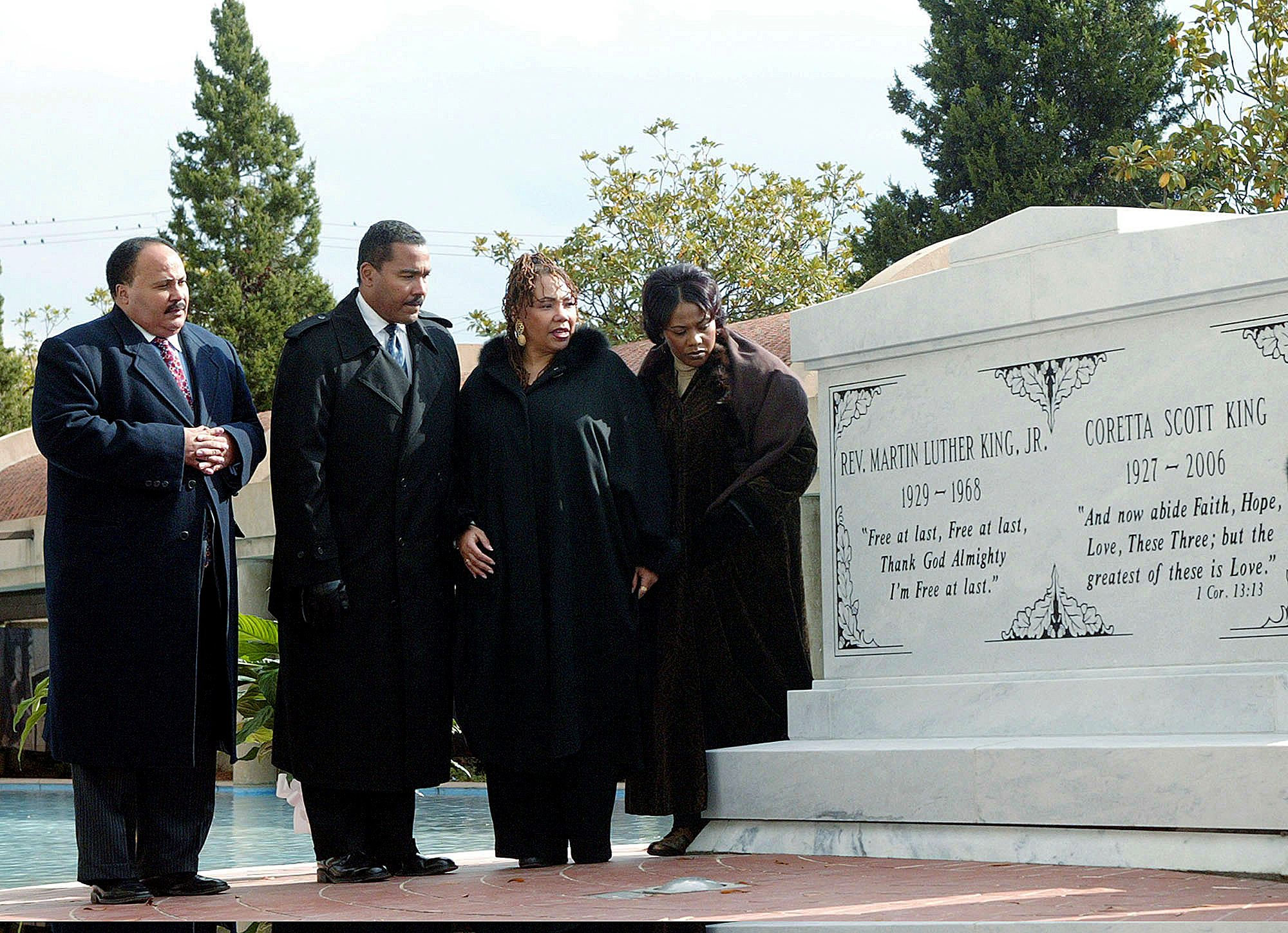 (From left) Martin Luther King III, Dexter King, Yolanda King and Bernice King stand next to a crypt dedicated to their parents in Atlanta on Nov. 20, 2006.