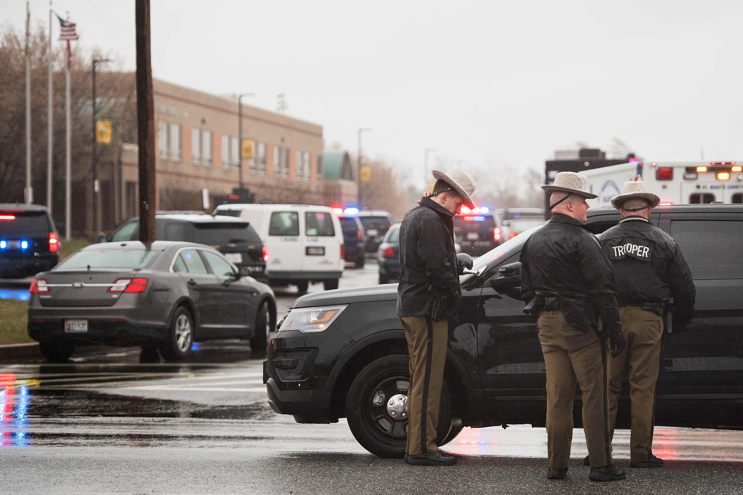 Maryland State Troopers gather on March 20, 2018 at Great Mills High School in Great Mills, Maryland after a shooting at the school.