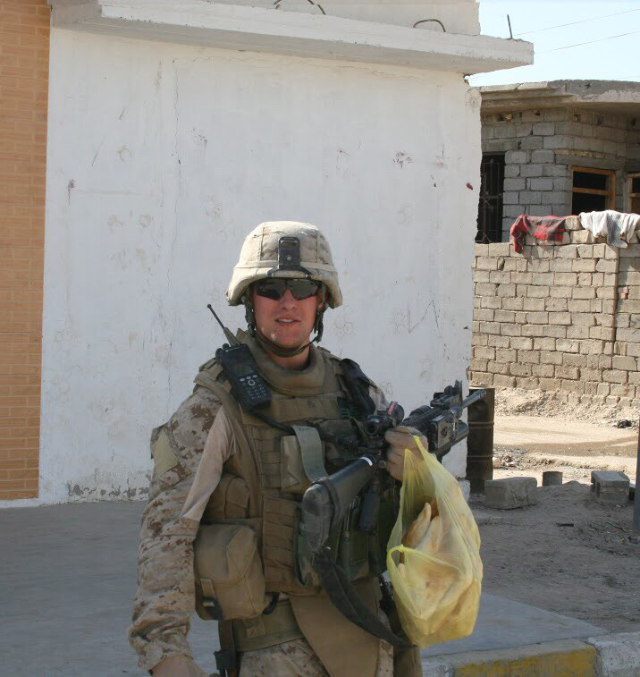 The author, carrying a bag of samoon — a type of bread — while on patrol in Fallujah, Iraq, in late 2007.