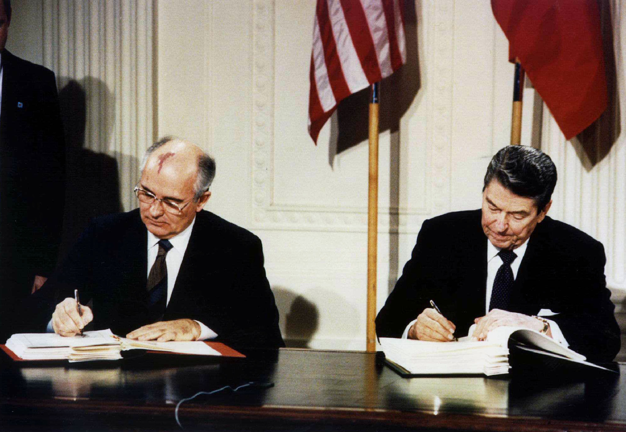 Mikhail Gorbachev, President of the Soviet Union, and President Reagan sign the Intermediate-Range Nuclear Forces (INF) treaty in the White House on Dec. 8, 1987.