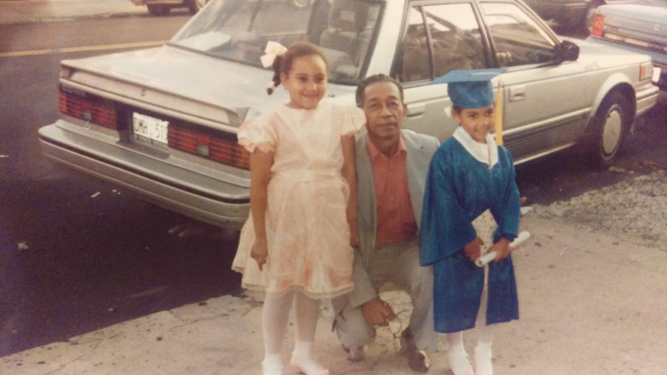 Oniqa and Sade Moonsammy as children with their grandfather, James Small.